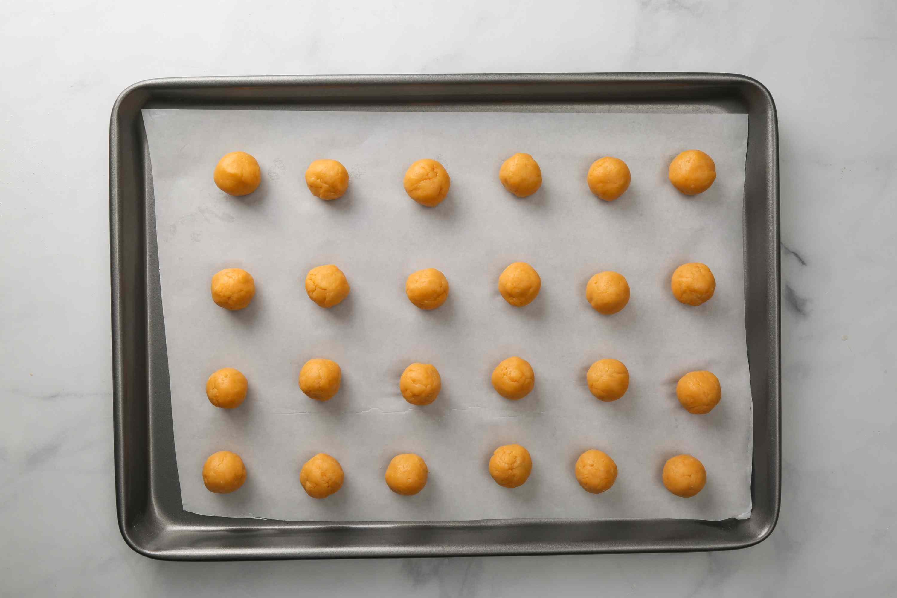 Olive Cheese Balls With Cheese Spread on a baking sheet