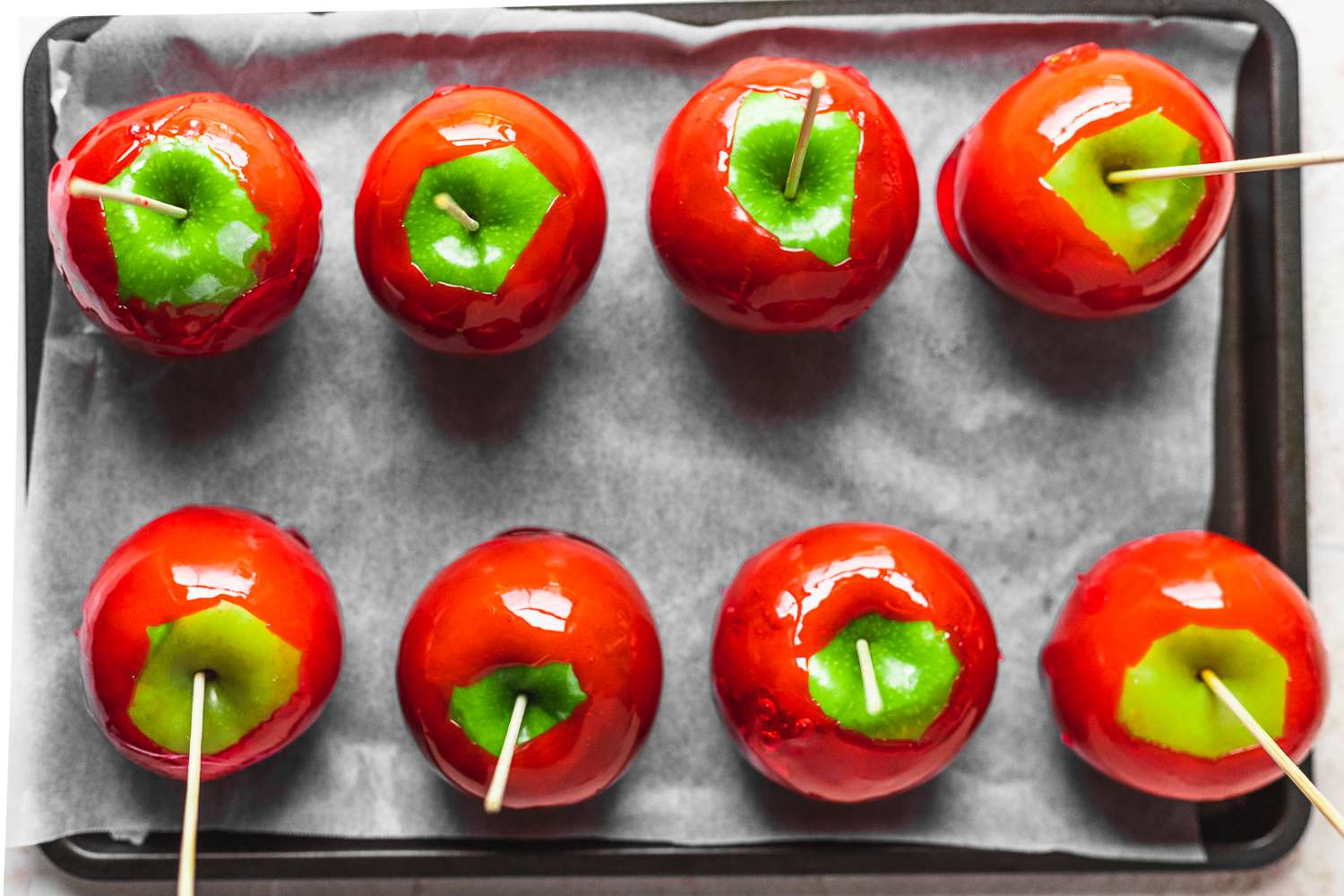 Candy Apples on a parchment paper lined baking sheet