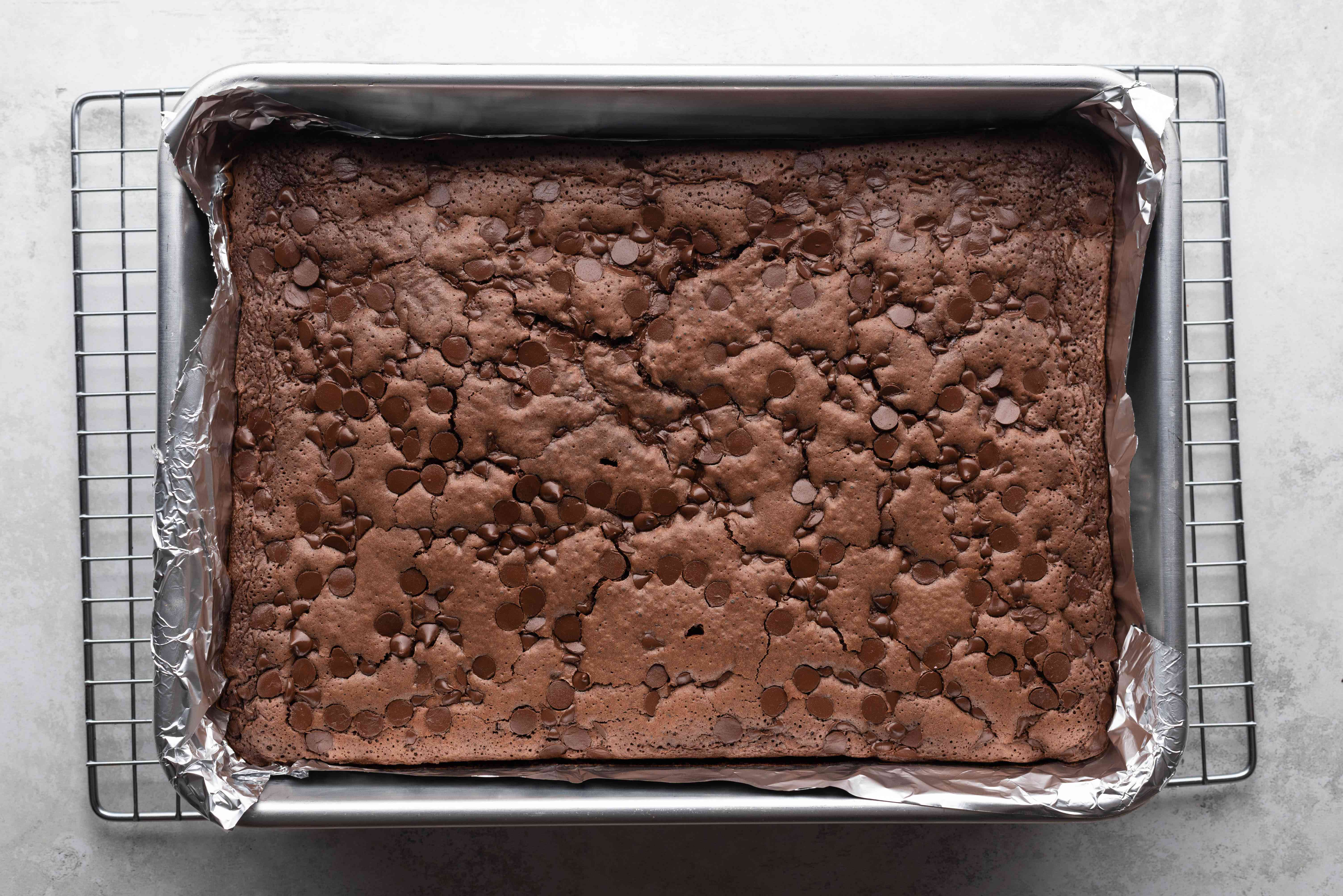 Guinness Stout Chocolate Brownies in a baking pan on a cooling rack