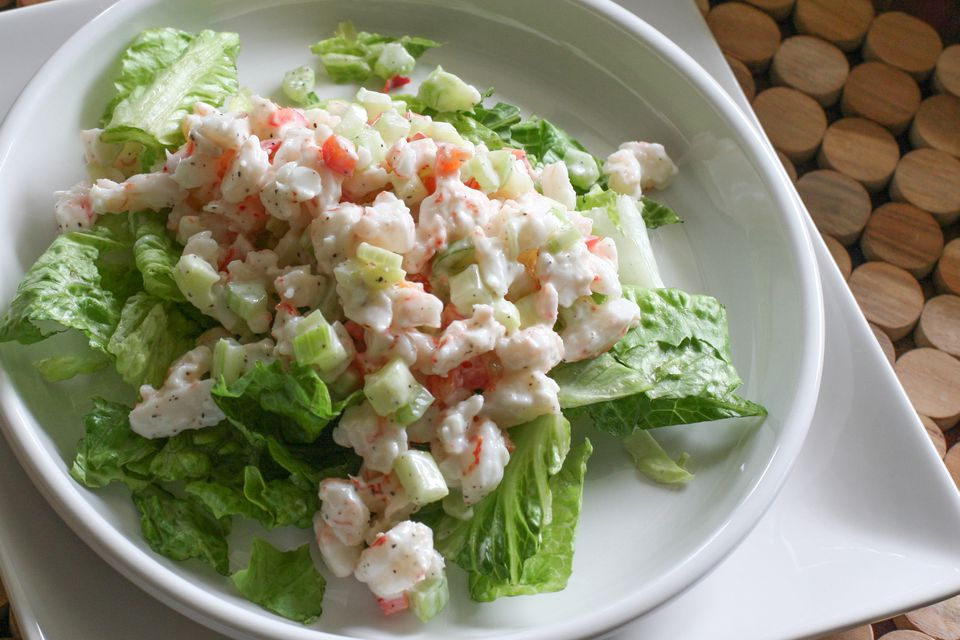 Close up of shrimp salad on a bed of lettuce.