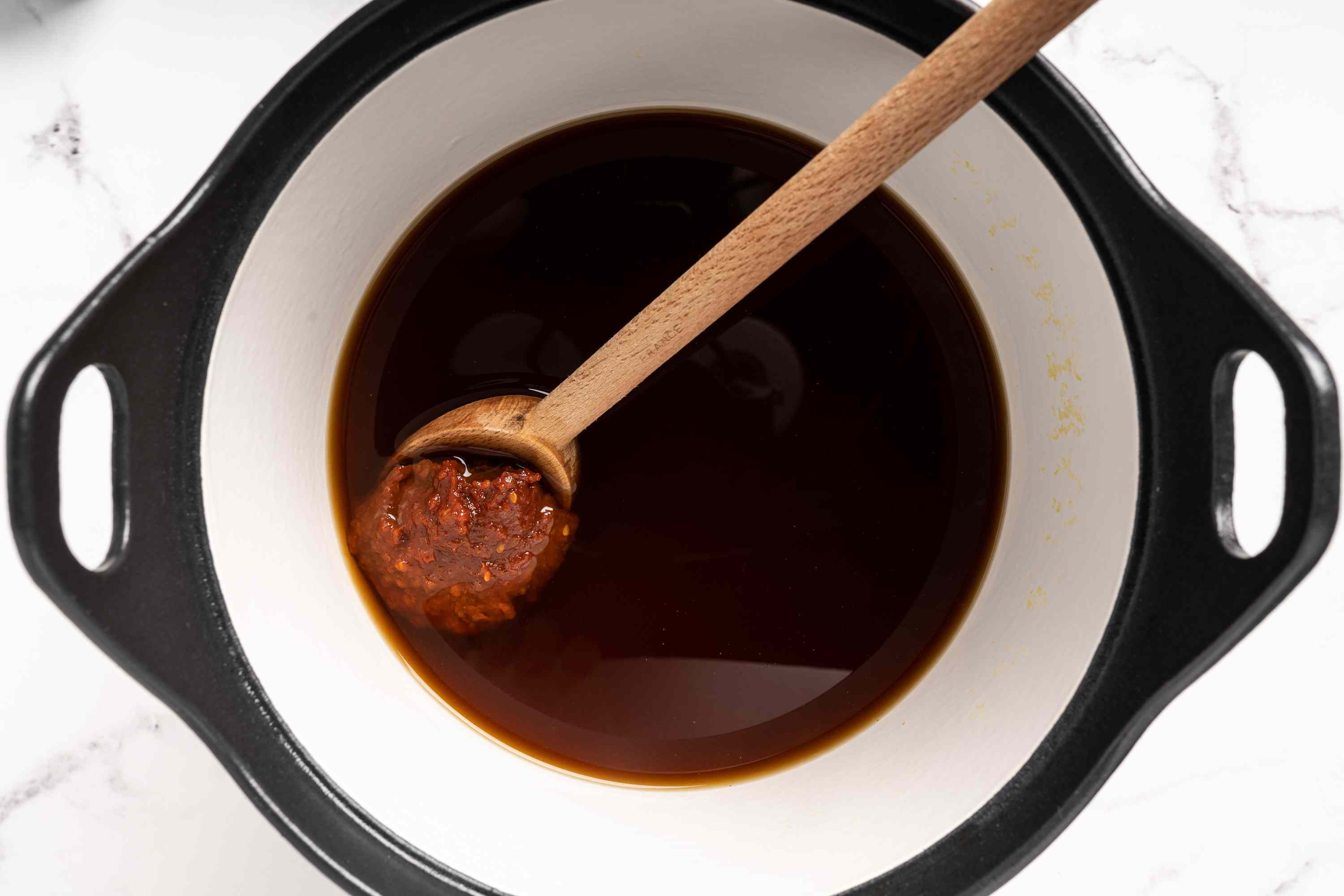 Add the soybean paste (daenjang) to the pot with beef broth