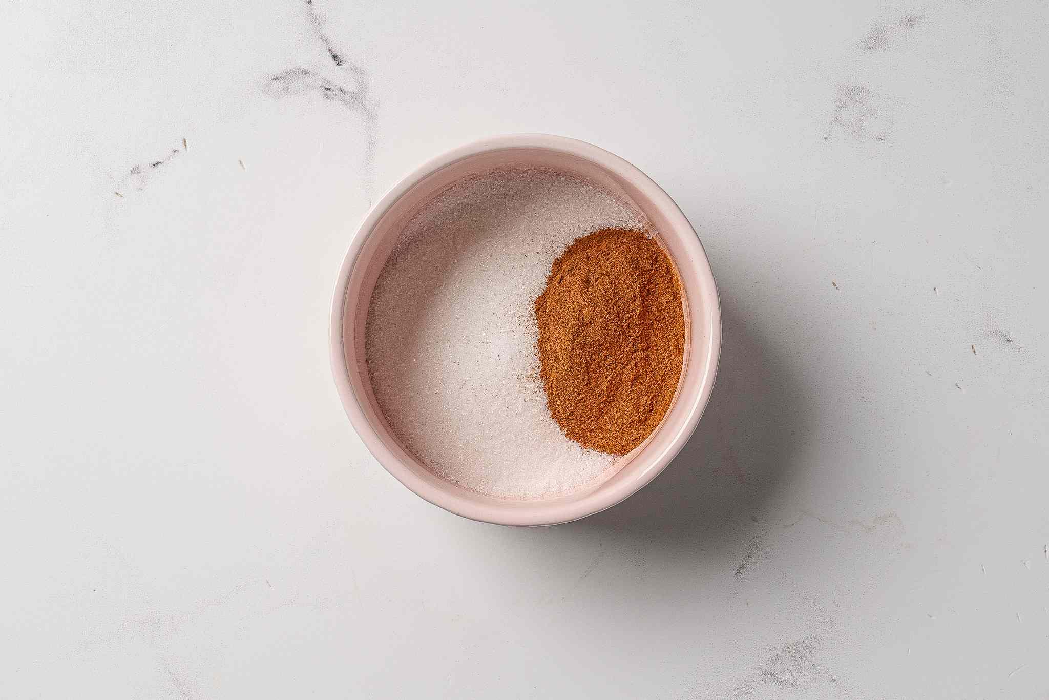 Sugar and cinnamon in a small bowl
