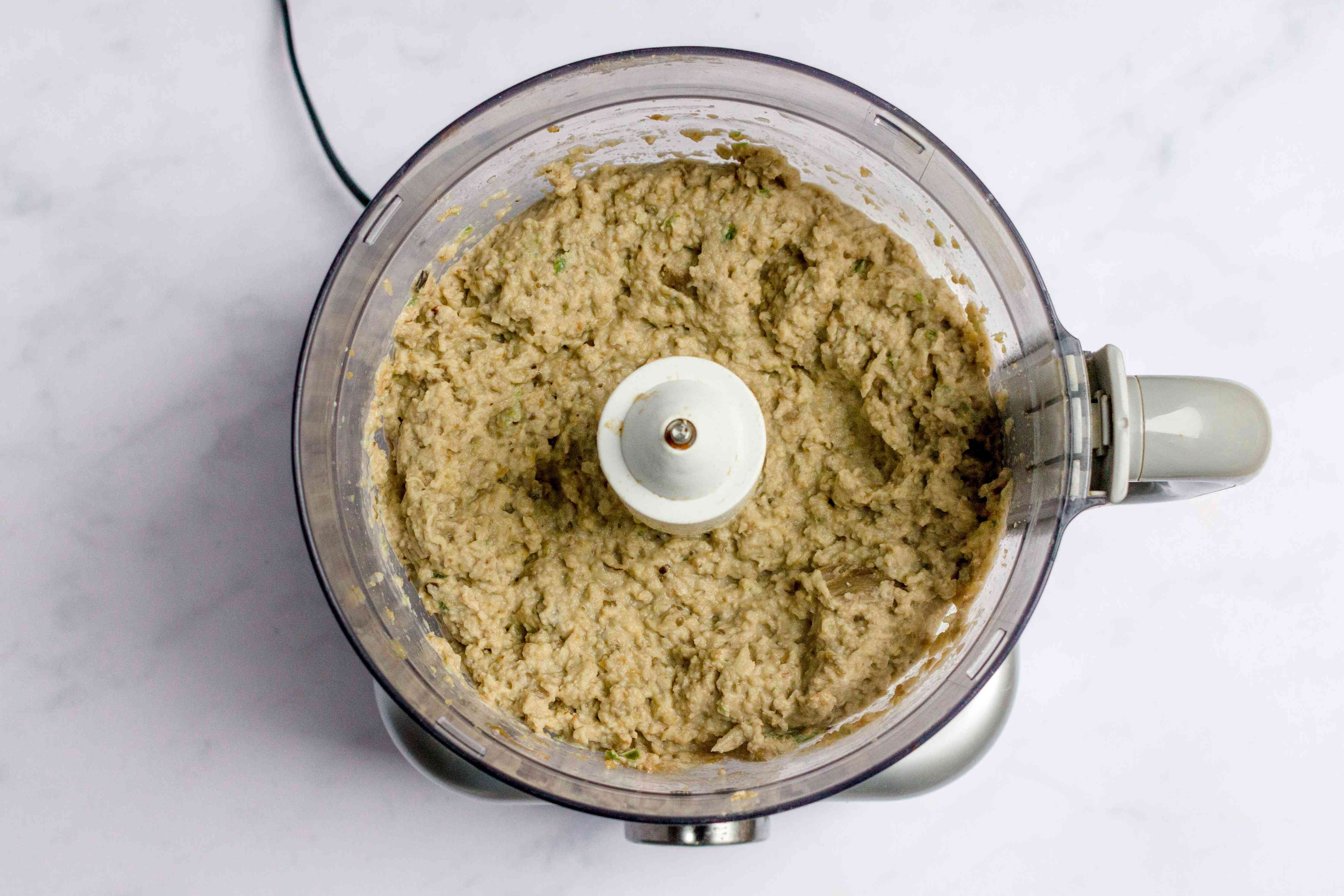 add eggplant to the spices in the food processor