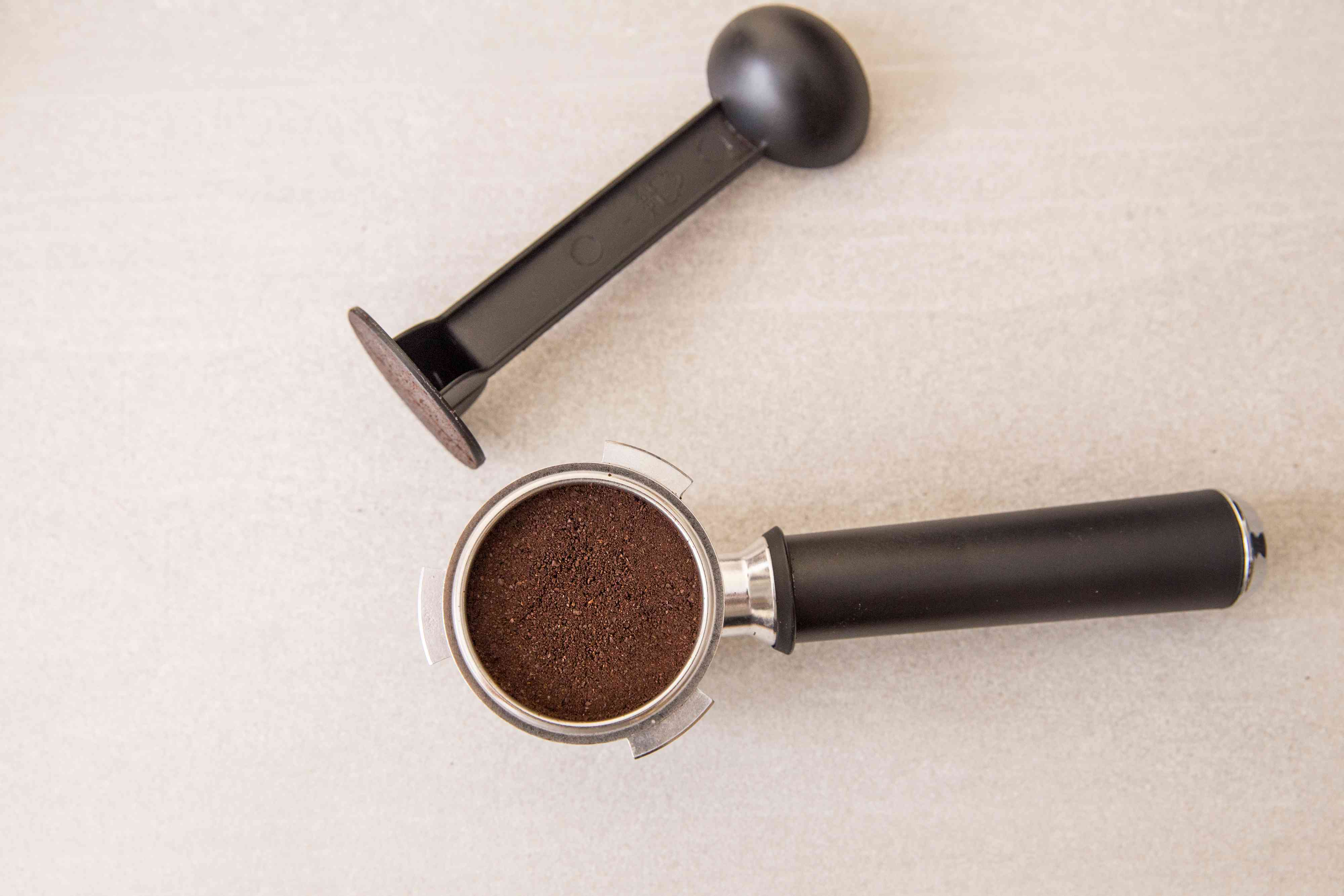 Tamp (press) the coffee down using a tamper