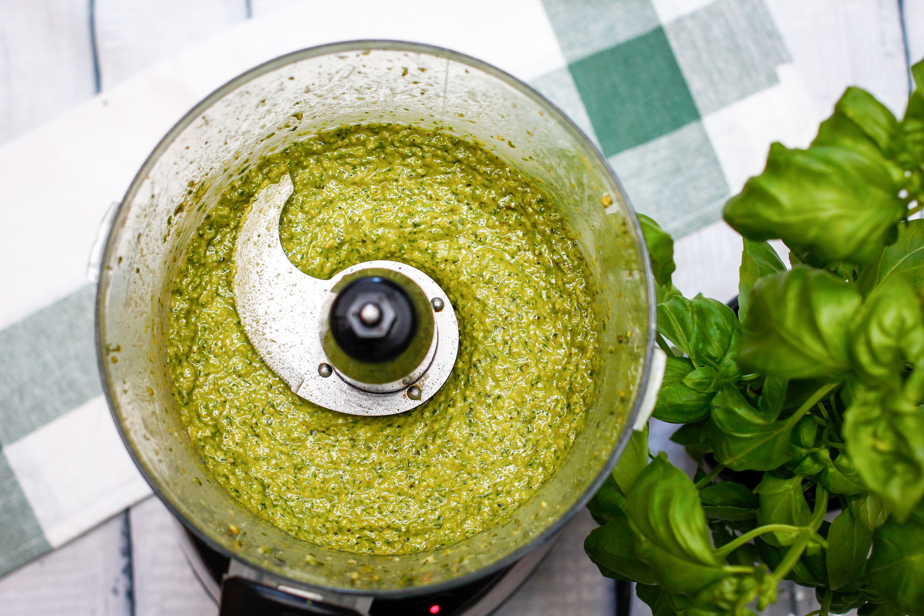 Pesto sauce blended into a paste in a food processor