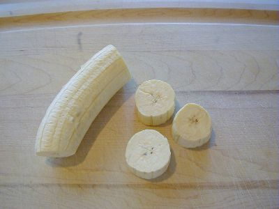 Sliced plantain on a cutting board.