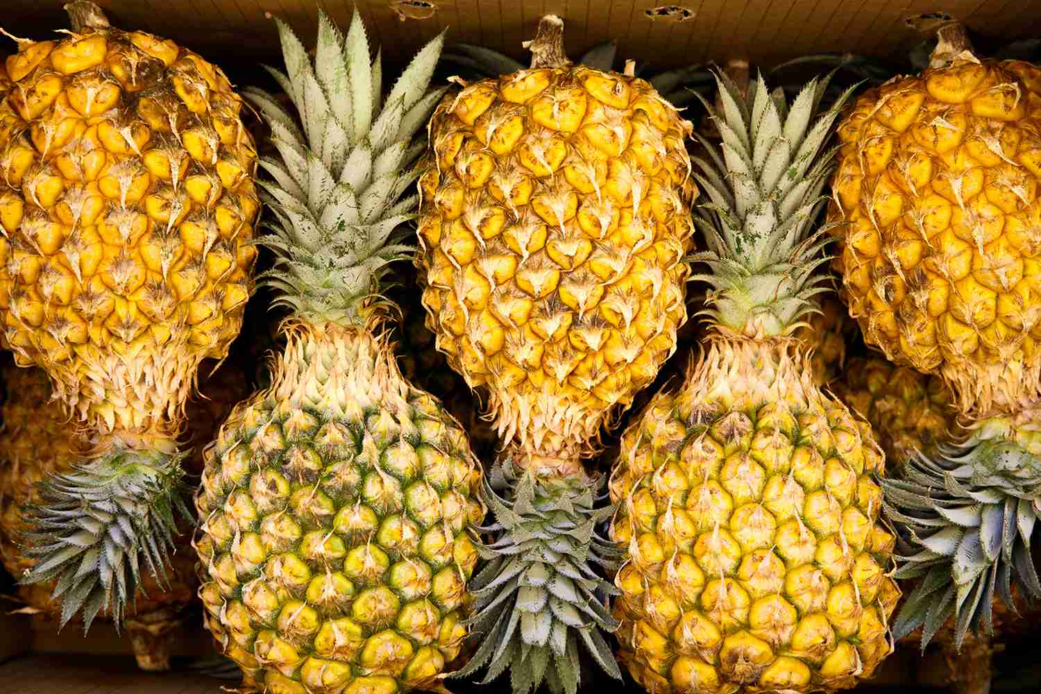 Close-Up Of Pineapples In Market