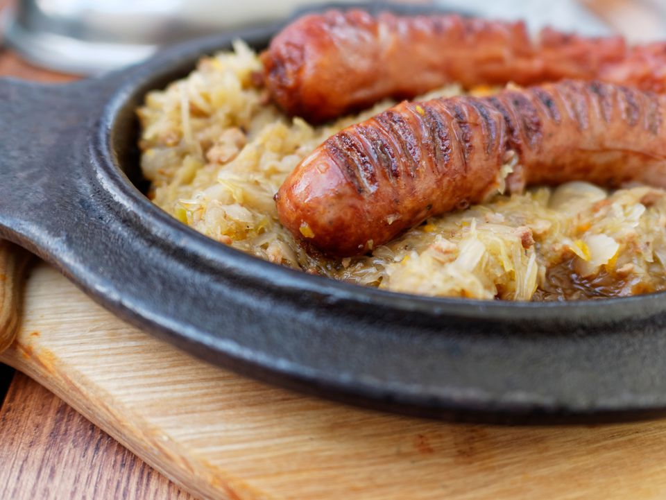 Polish sausage or kielbasa on top of sauerkraut