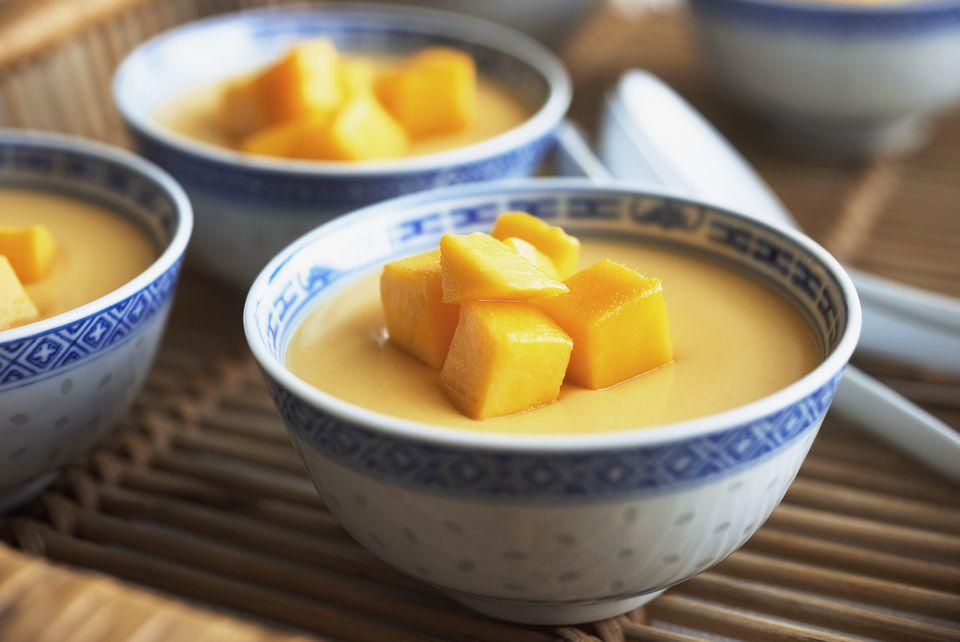 Bowls of mango pudding on a tray