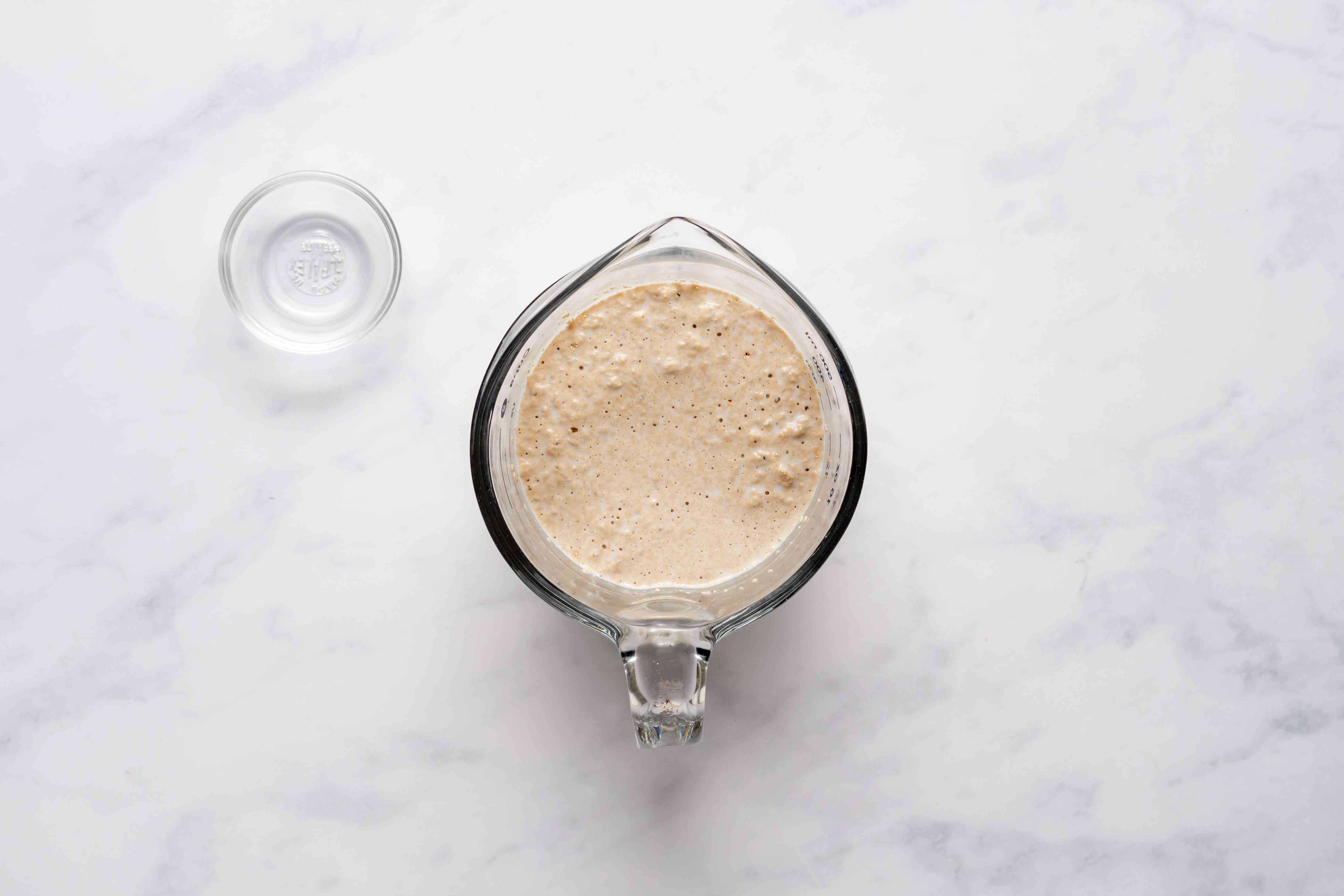 Mix the yeast with lukewarm milk in a measuring cup