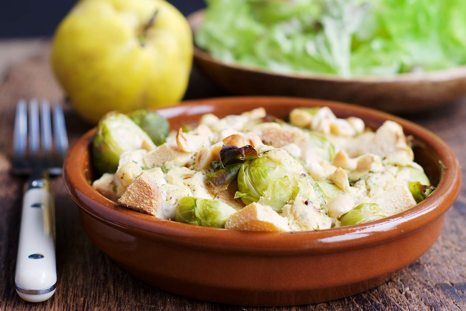 Brussels sprouts quince gratin with hazelnut sauce