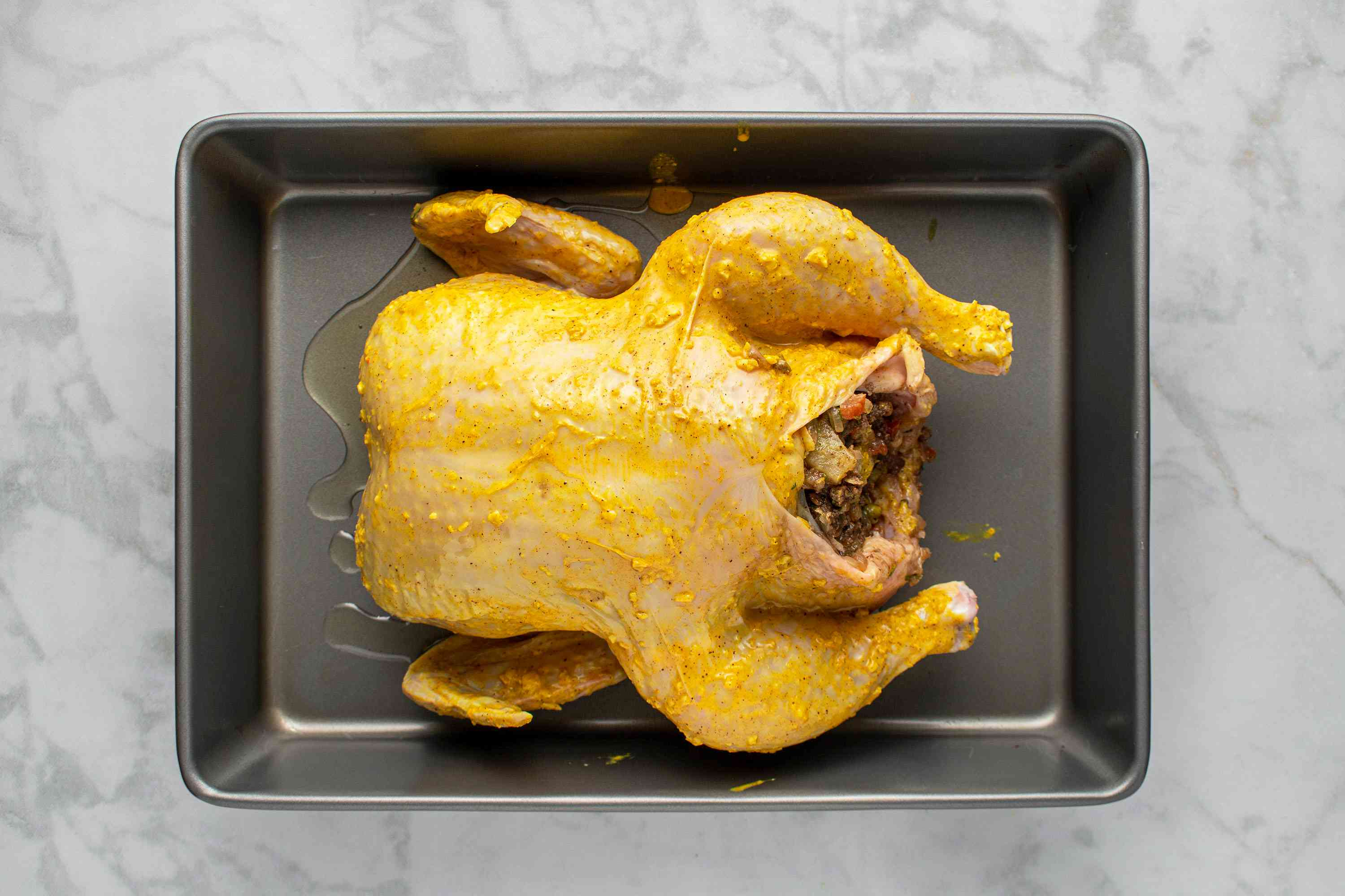 chicken with filling in a baking dish