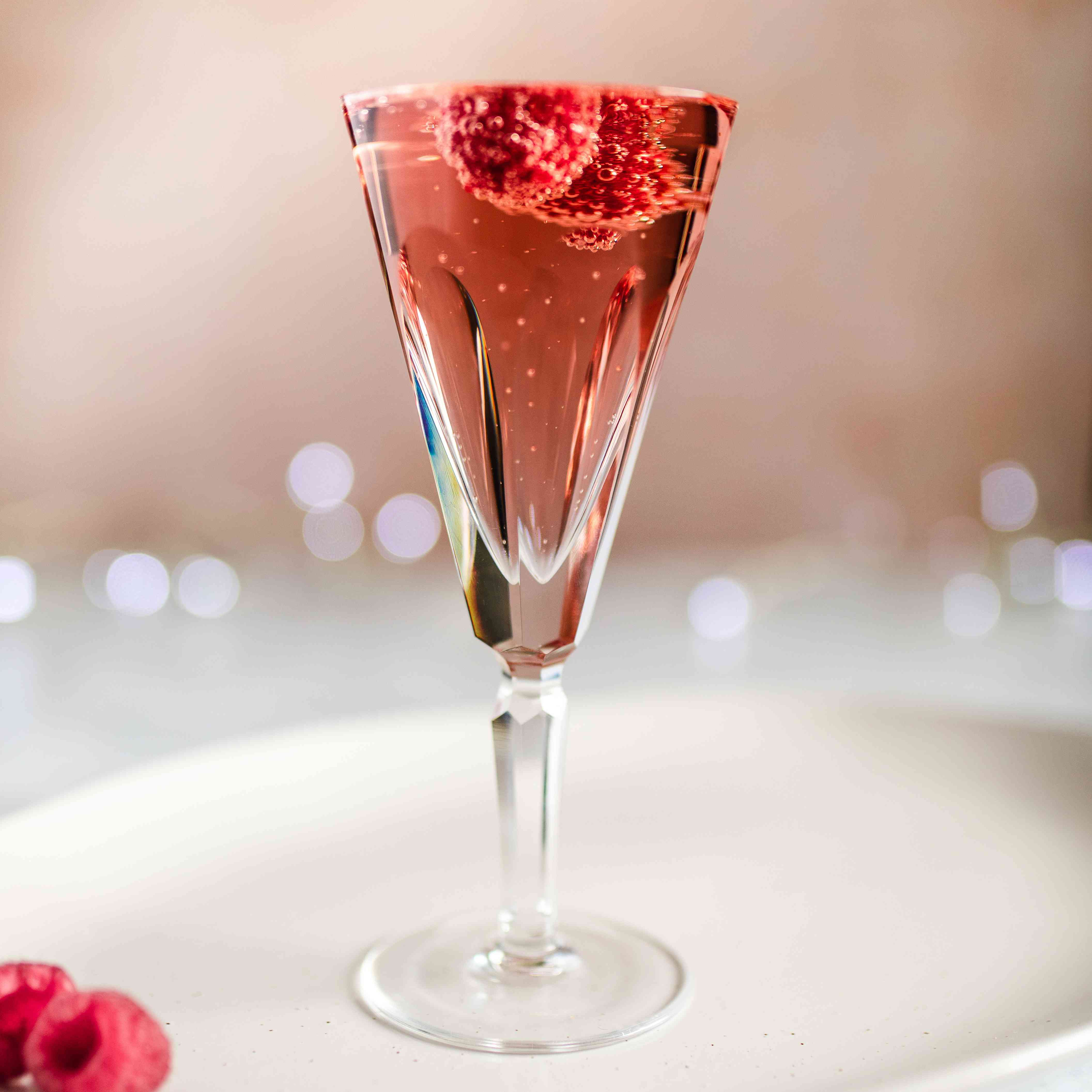 champagne and chambord with raspberries on top