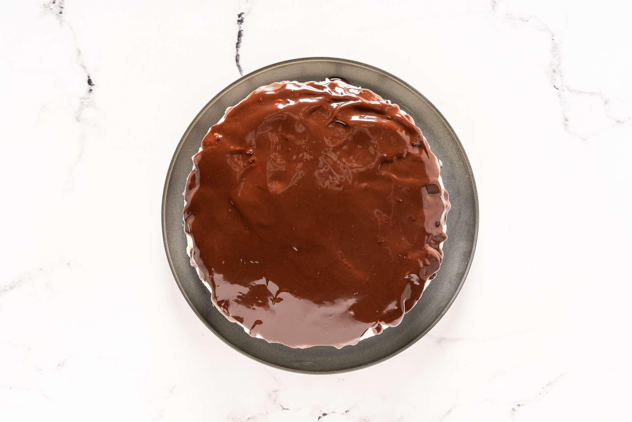 Chocolate ganache poured over cake