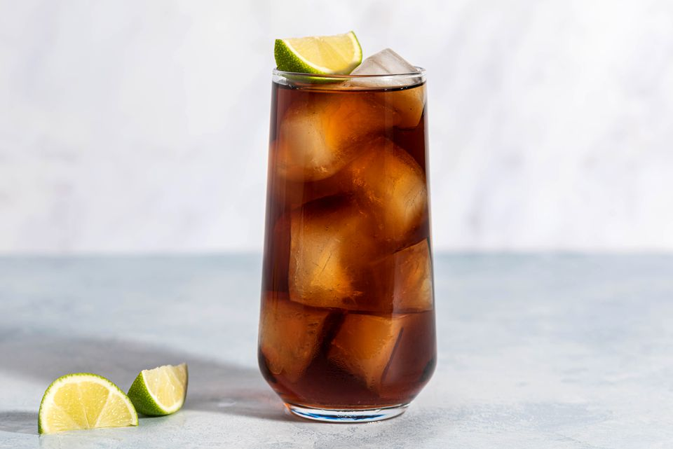 Rum and Coke on the rocks with a wedge of lime