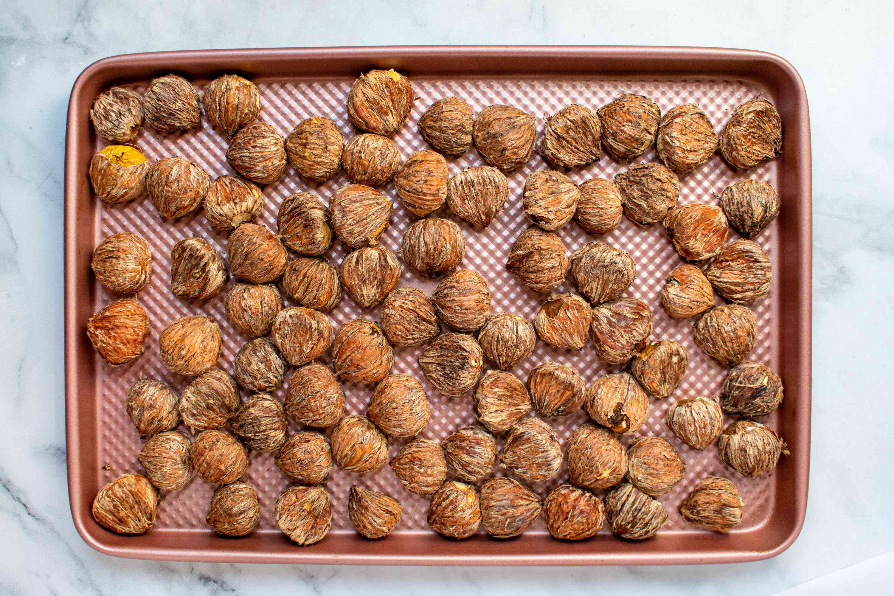 peeled chestnuts in a shallow ovenproof dish