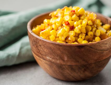 Southern fried corn in a small wooden bowl