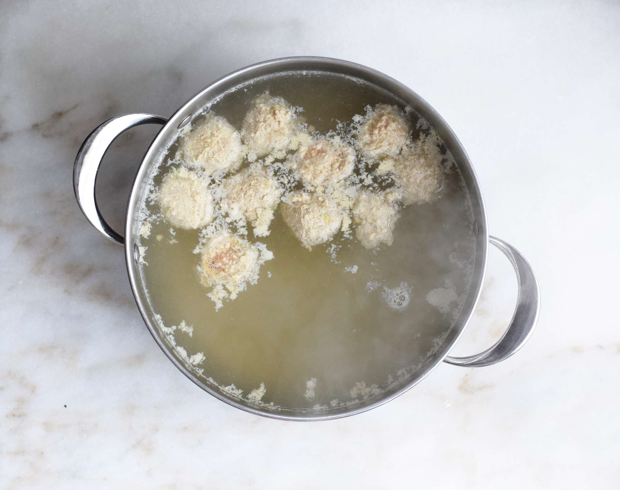 cooking meatballs in boiling water