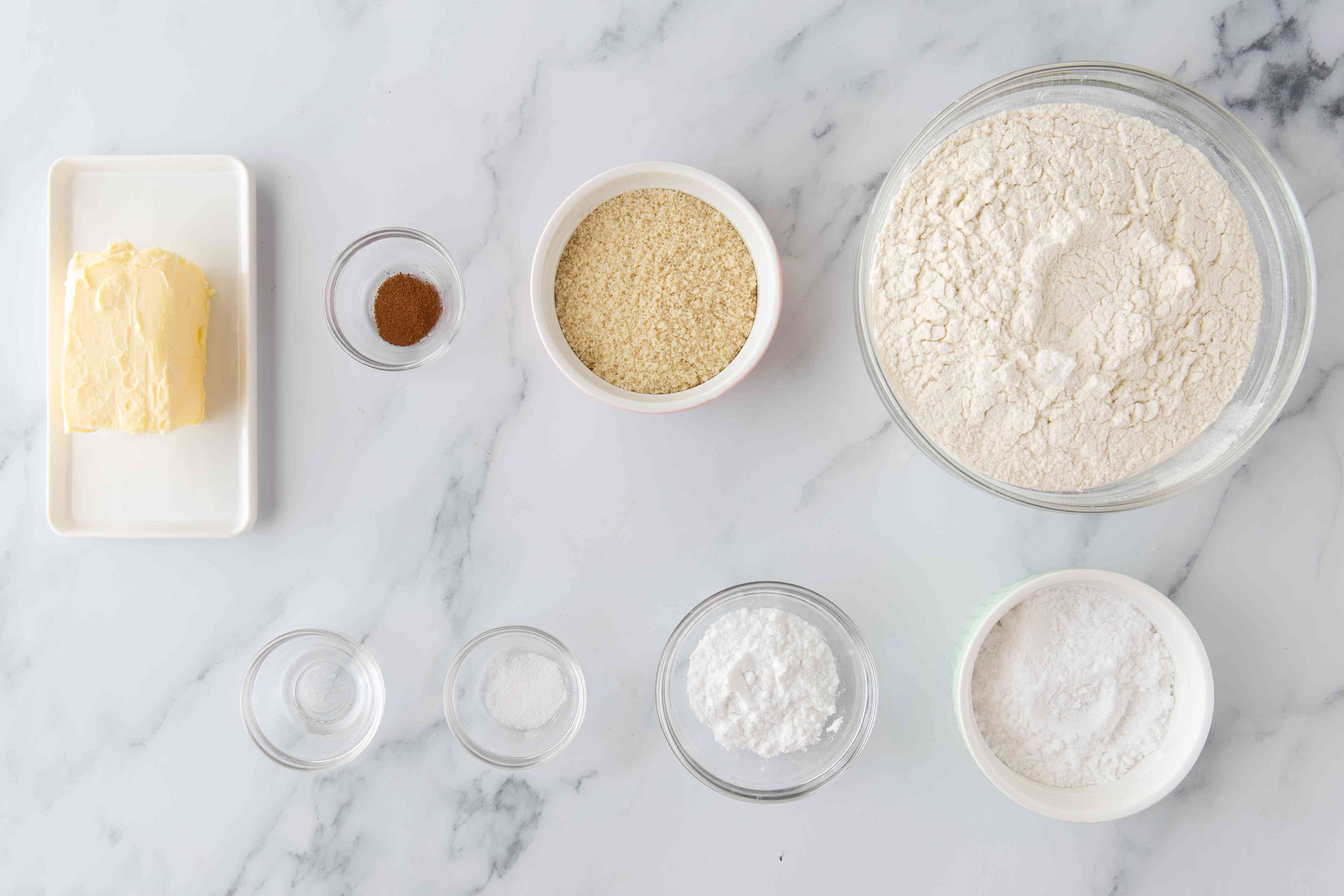 Ingredients for crumbly almond cookies polvorones de almendra