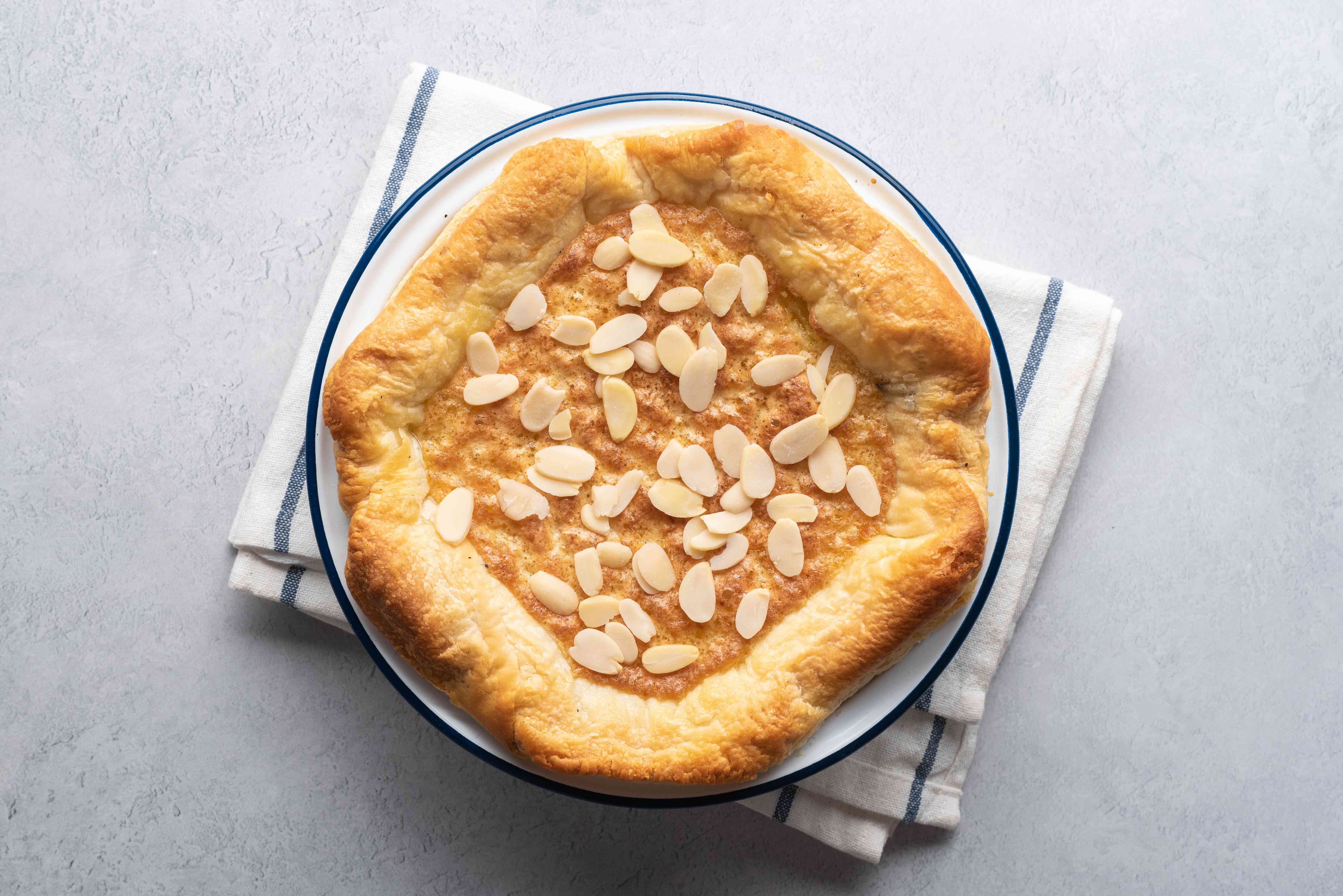 Remove the pudding from the oven and sprinkle on the sliced almonds