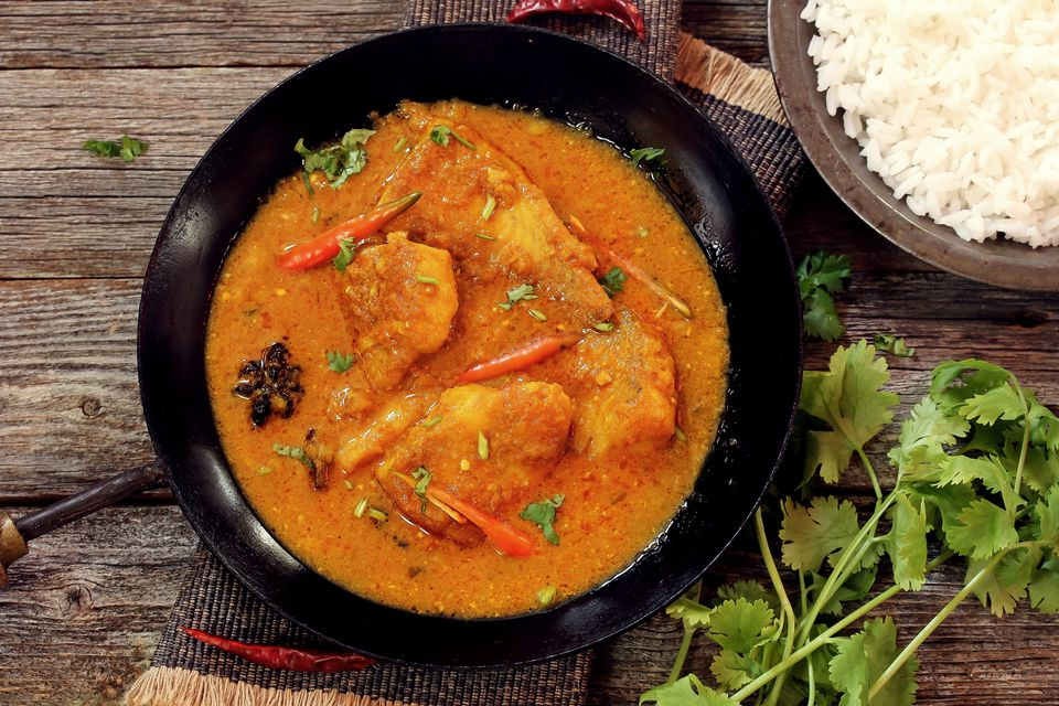 Indian yogurt food and beverage recipes bengali fish curry doi maach cooked in yogurt gravytop down view forumfinder Choice Image