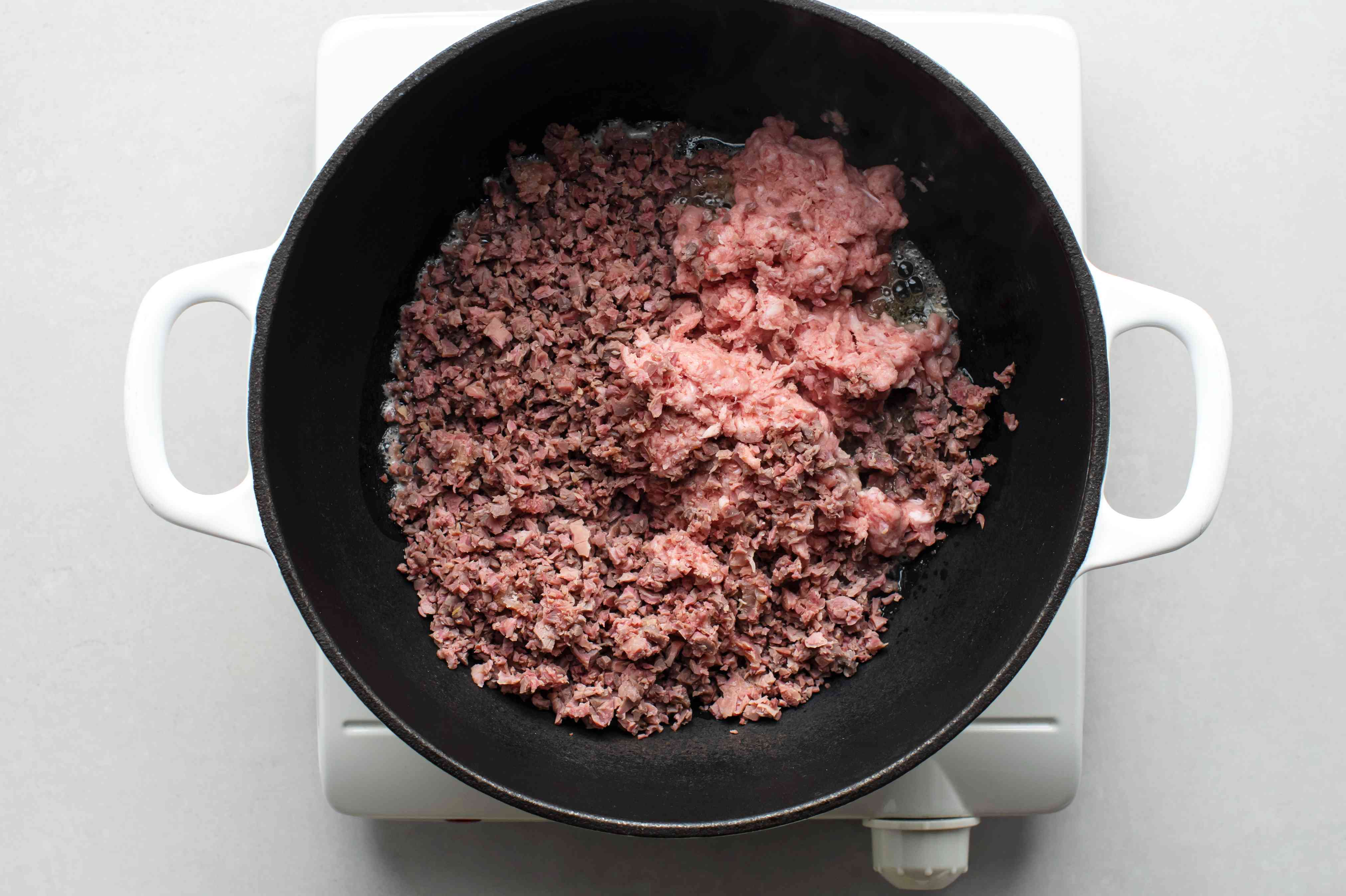 Adding pork and gizzards to a Dutch oven