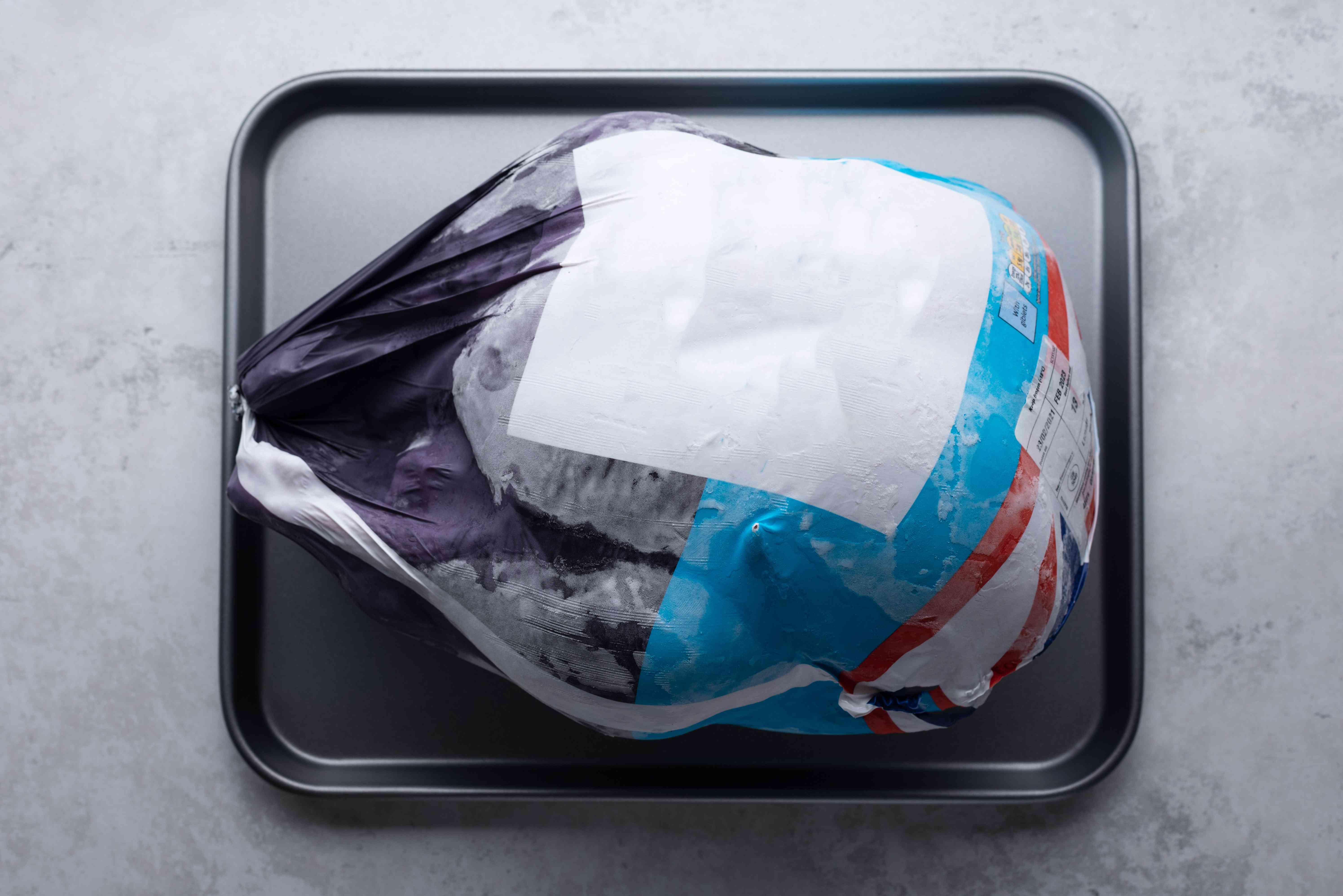 frozen turkey on a baking sheet