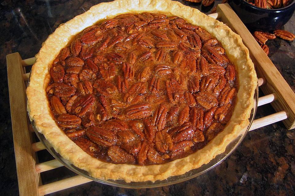 Brown sugar pecan pie on wooden cooling rack