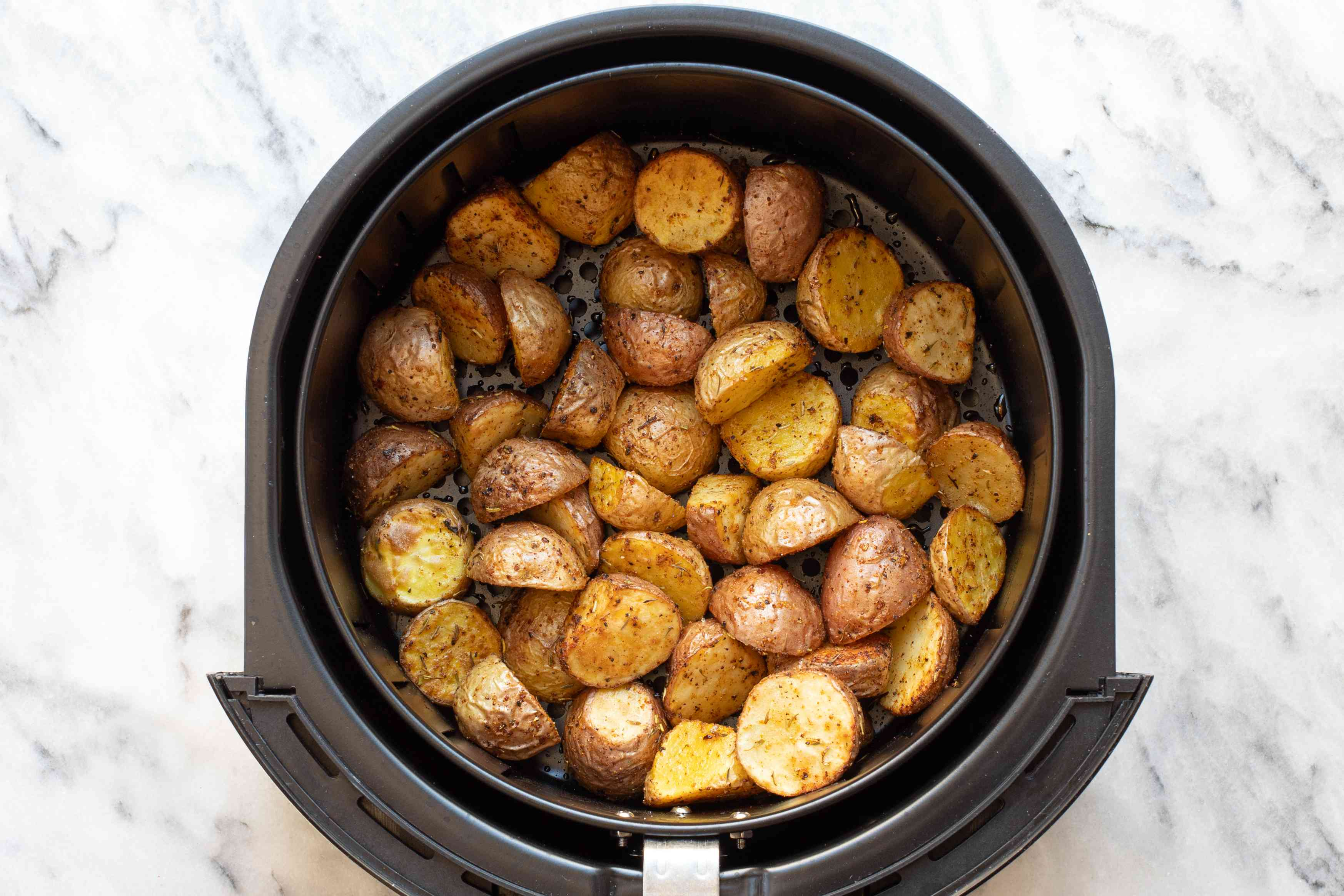 Air fryer potatoes halfway through cooking