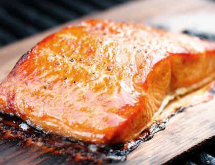Grilling a salmon fillet on a cedar plank