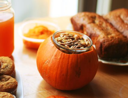Toasted pumpkin seeds with other fall foods on table