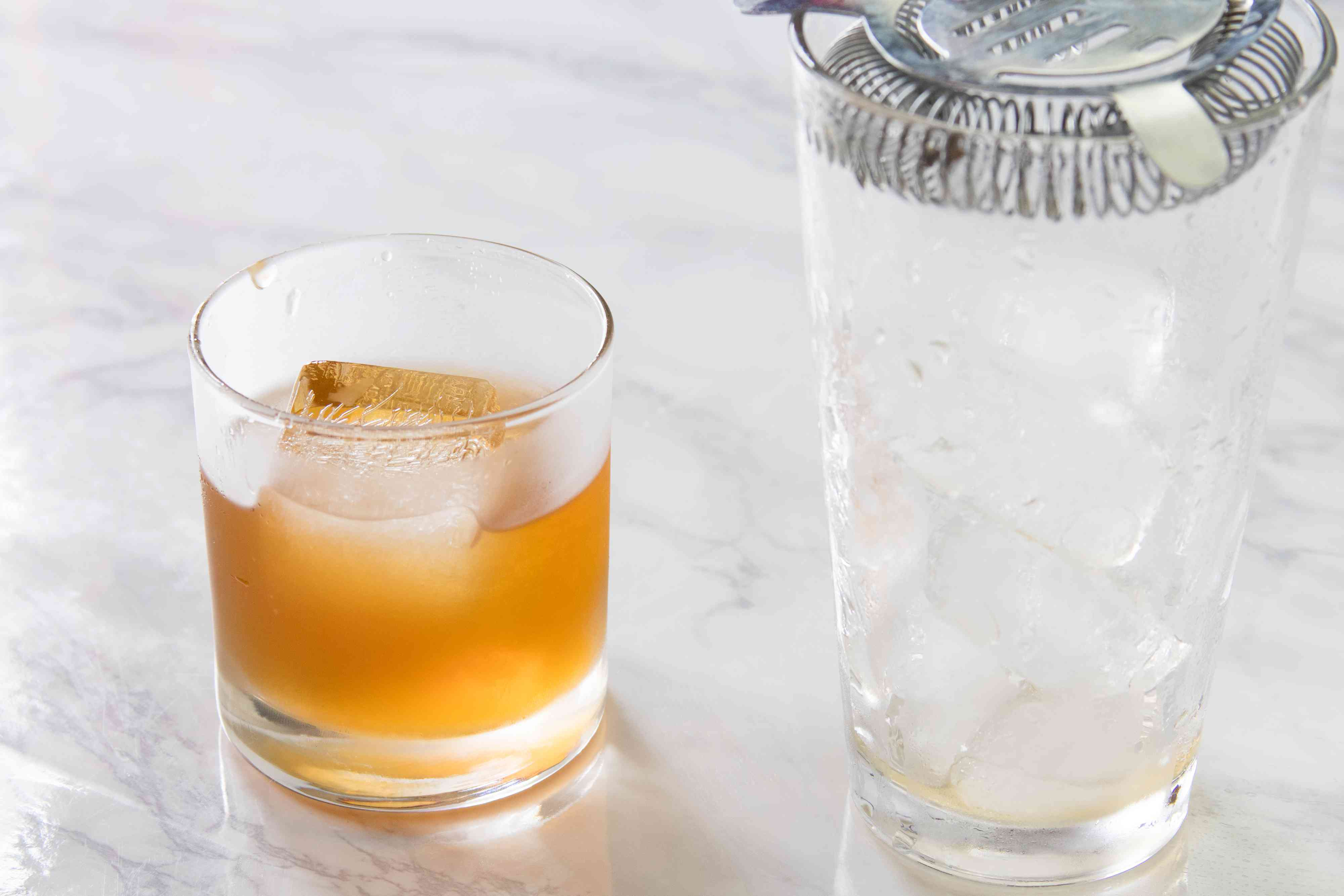 Straining an Amaretto Sour
