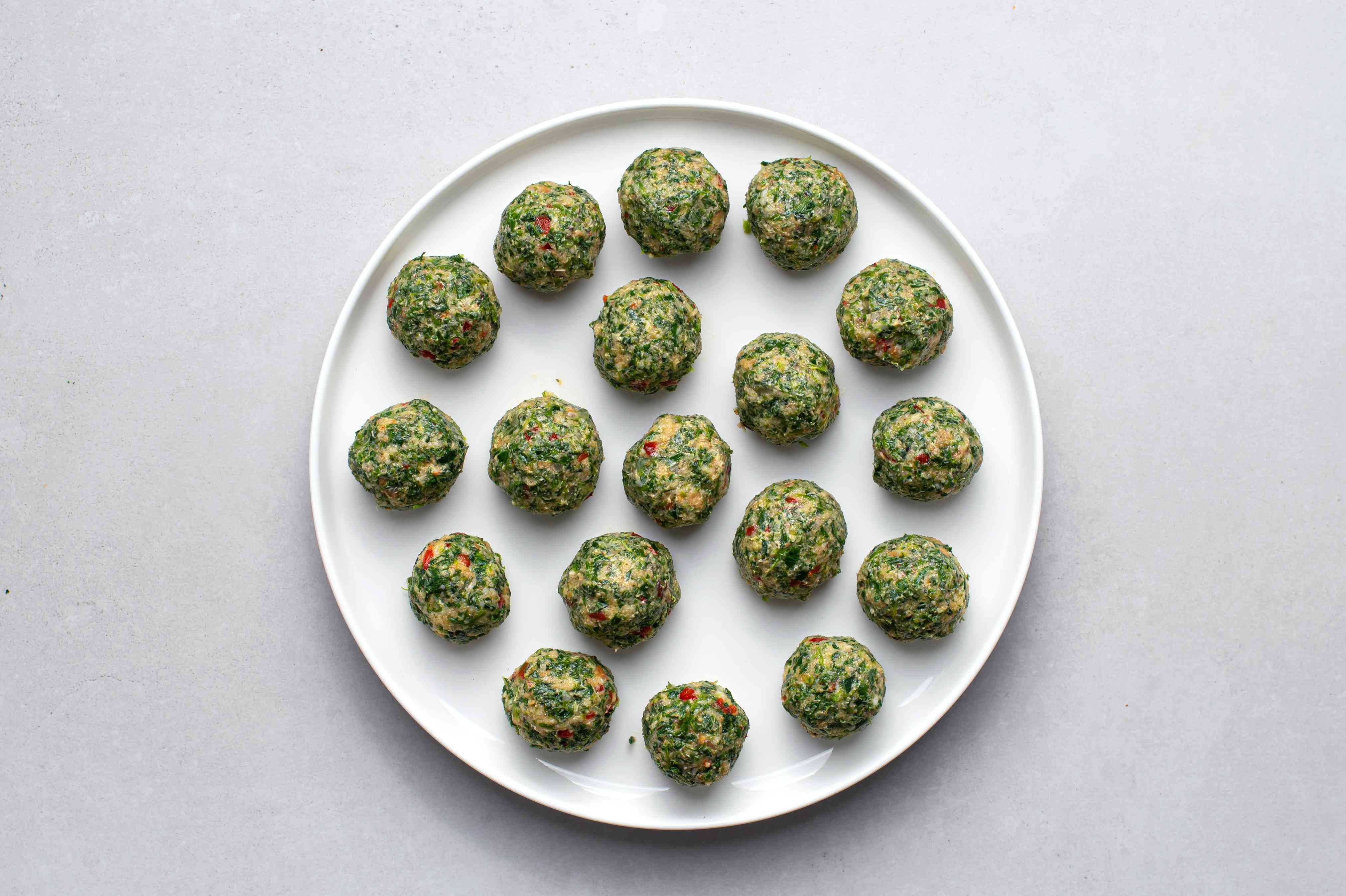 spinach balls on a plate