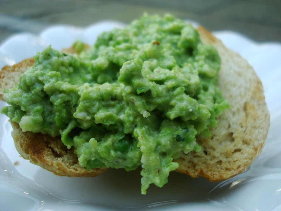 Pea and Walnut Pesto served crostini-style on rustic wheat bread