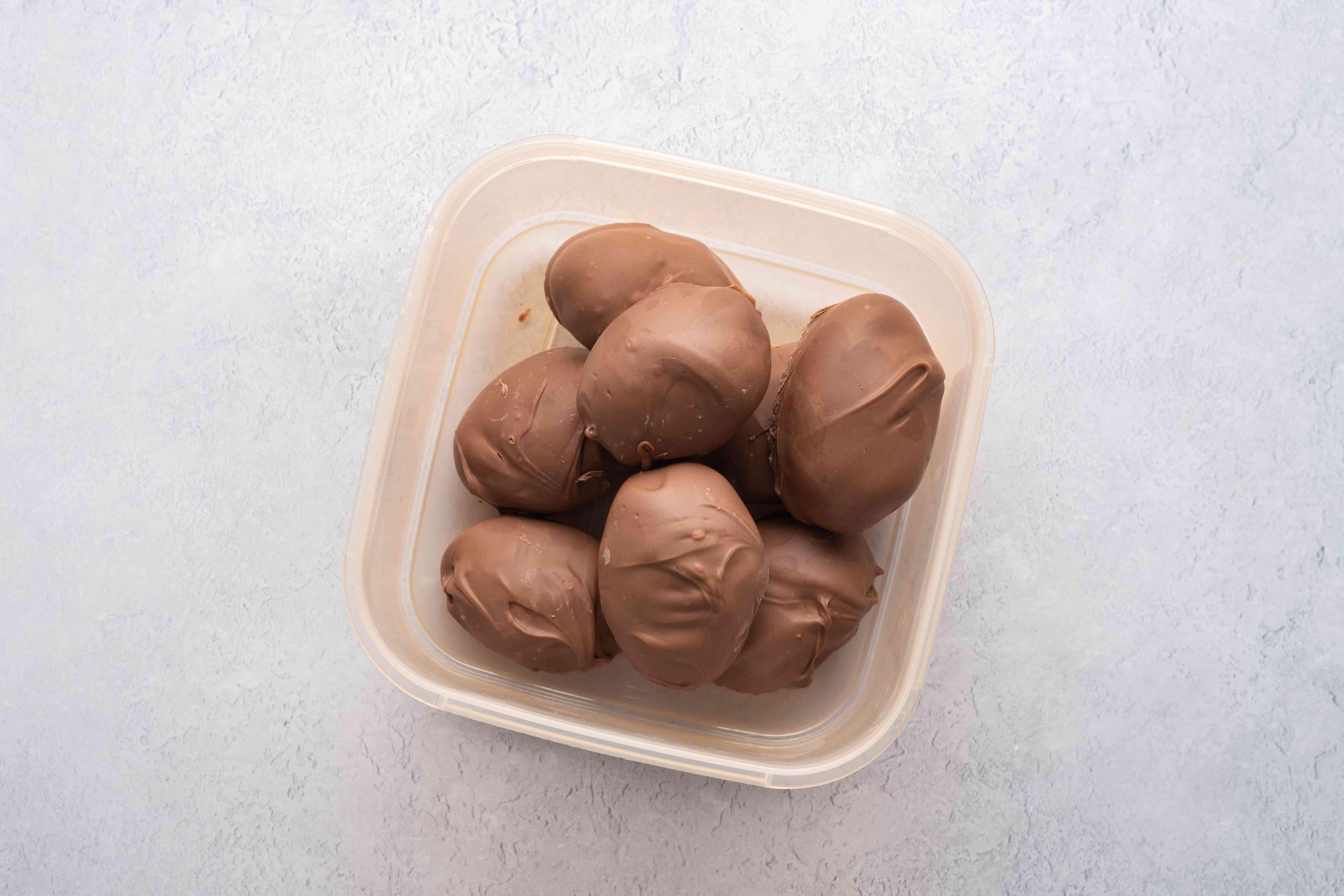 chocolate creme eggs in plastic container