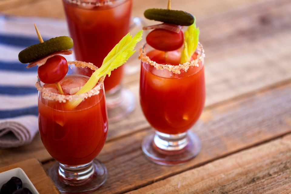 Two bloody marys on a wooden table