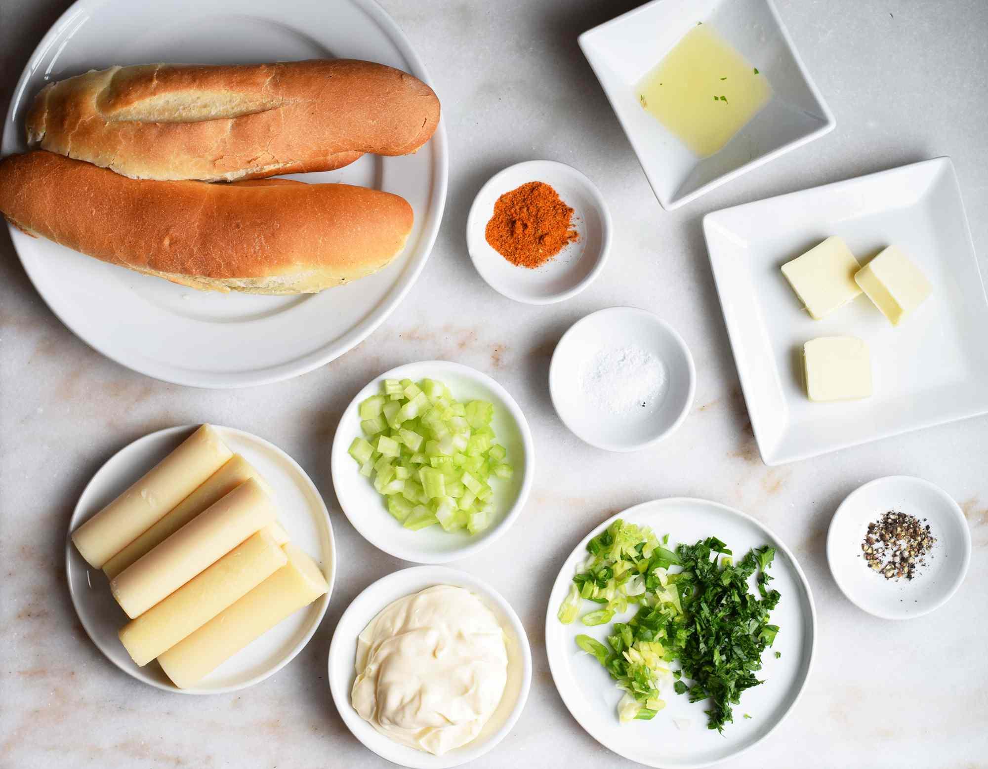 vegan lobster roll ingredients on a marble platter