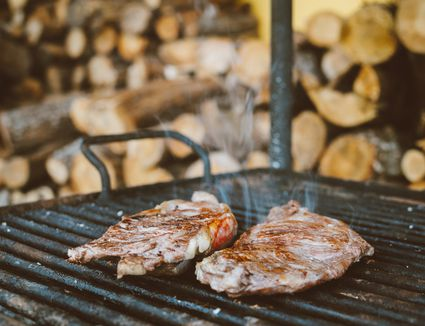 Beef steaks cooking on a parrilla
