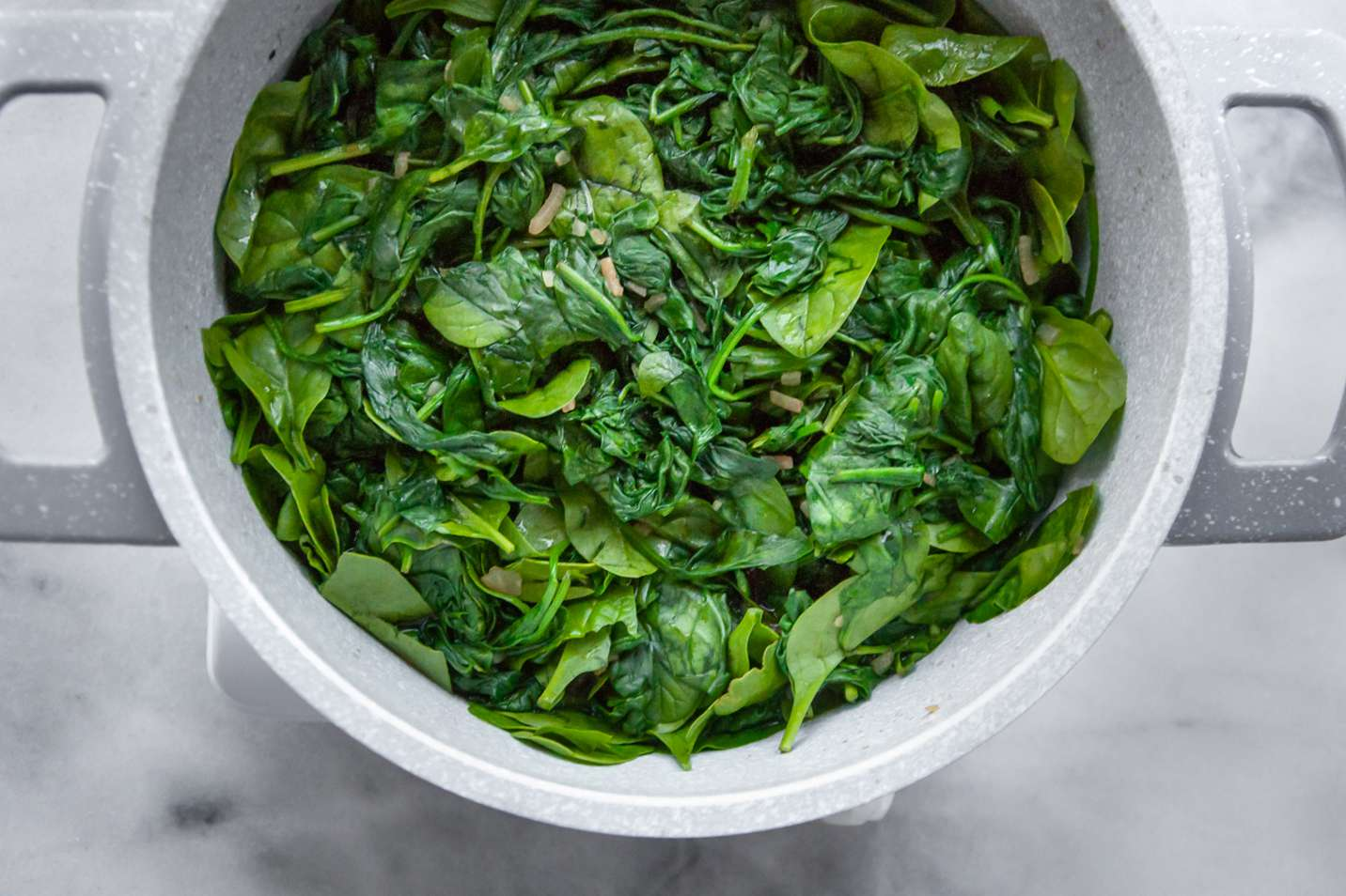 onion soup mix and spinach in a saucepan