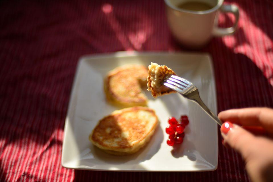 Eating oatmeal pancakes