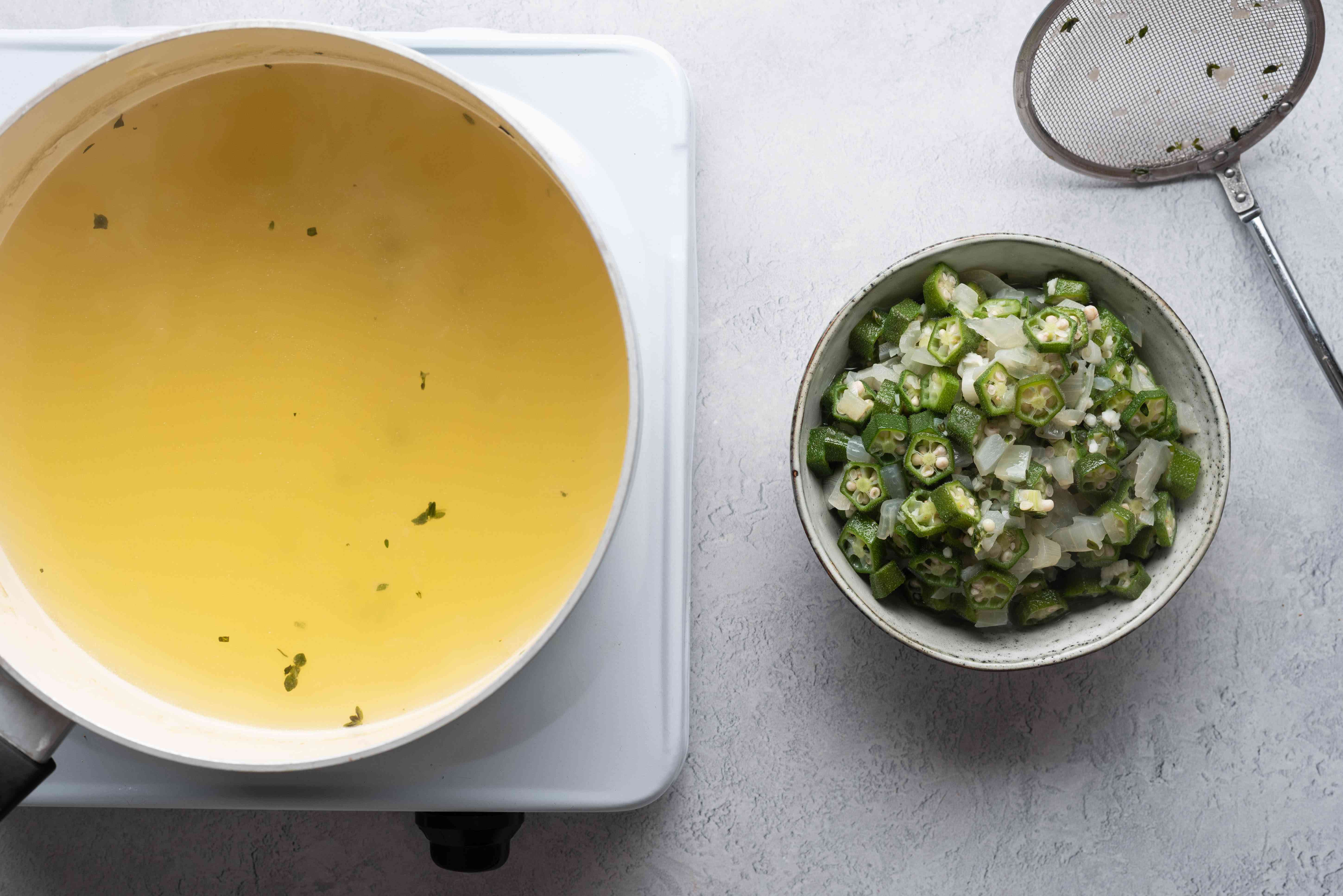 okra removed from liquid in a pot