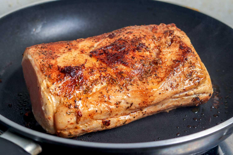 Sear pork in skillet