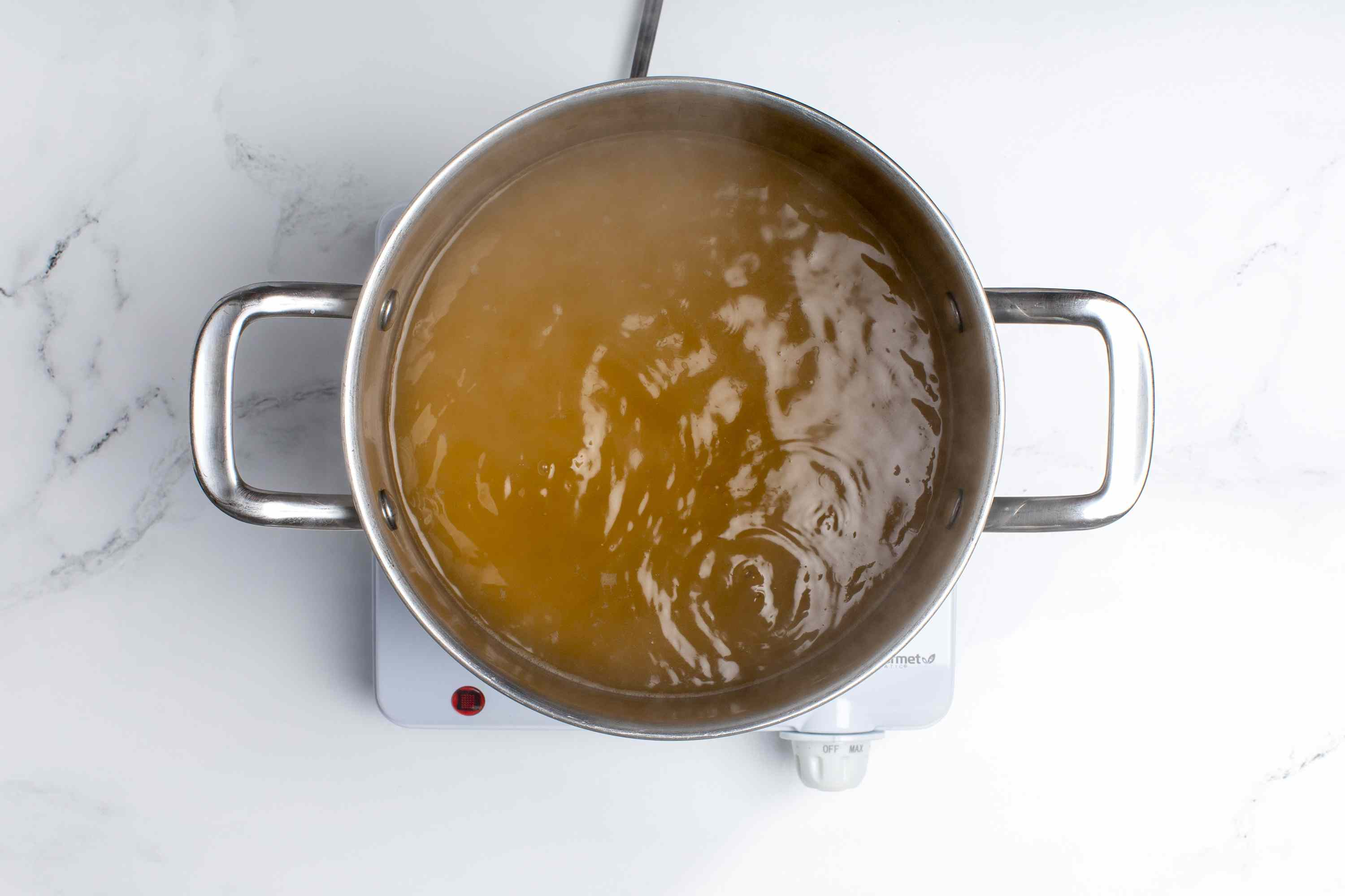 A pot of vegetable stock simmering
