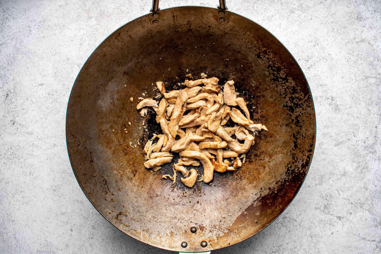 chicken cooking in a wok