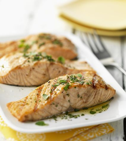 Fried salmon fillets on plate