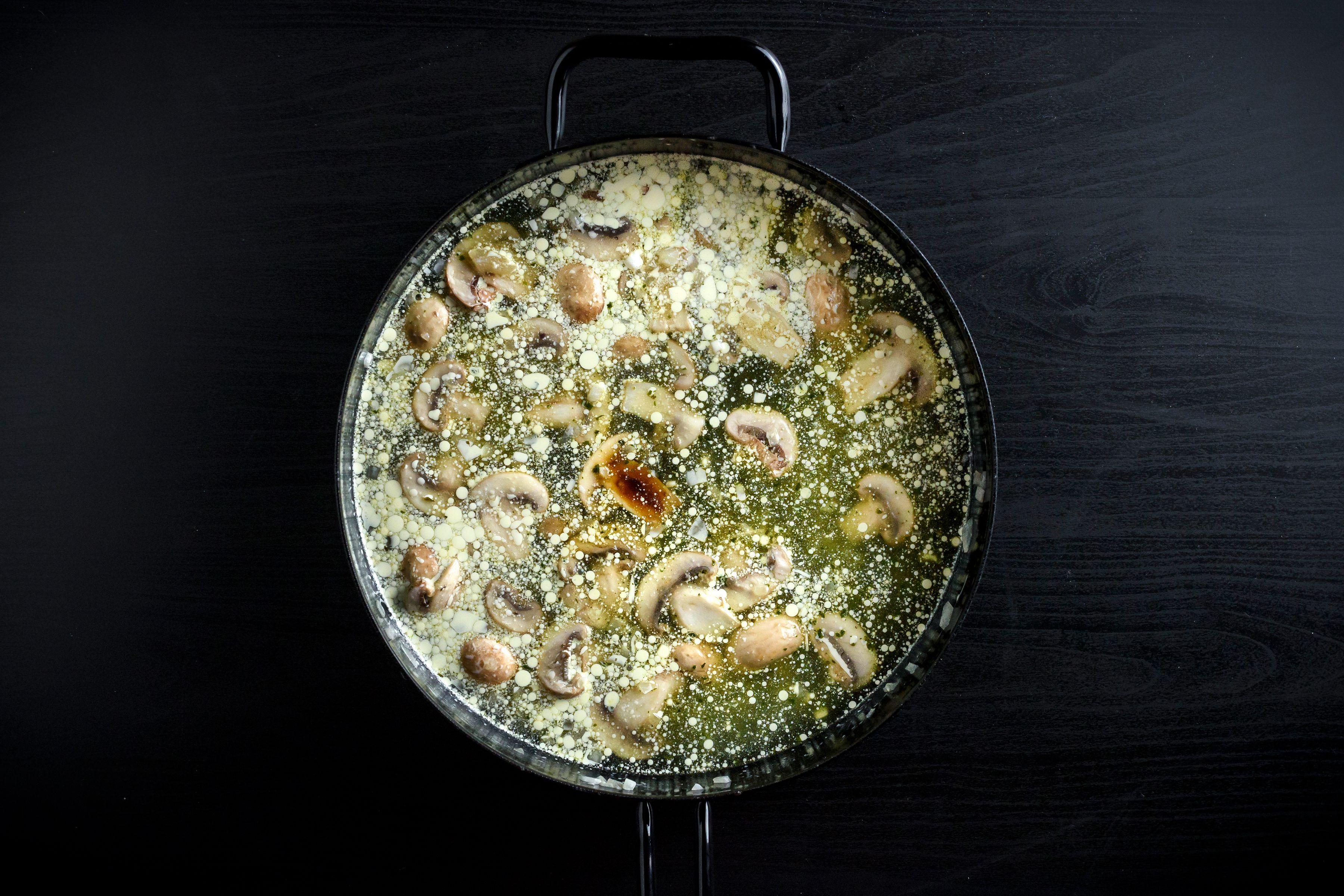 Mushroom gravy broth in pan