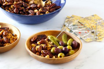 Spiced mixed nuts on plates with appetizers.