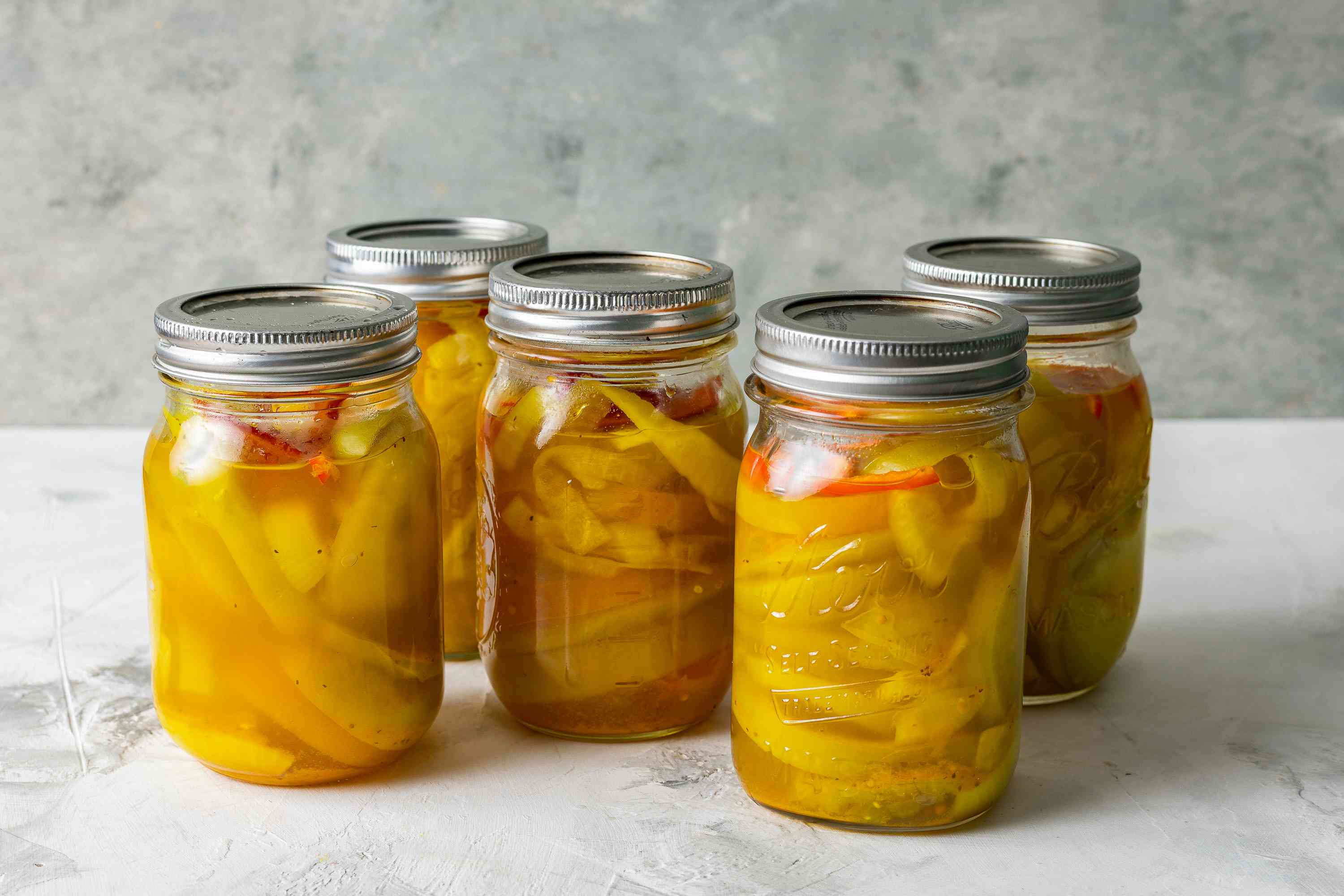 Pickled Green Tomatoes in jars