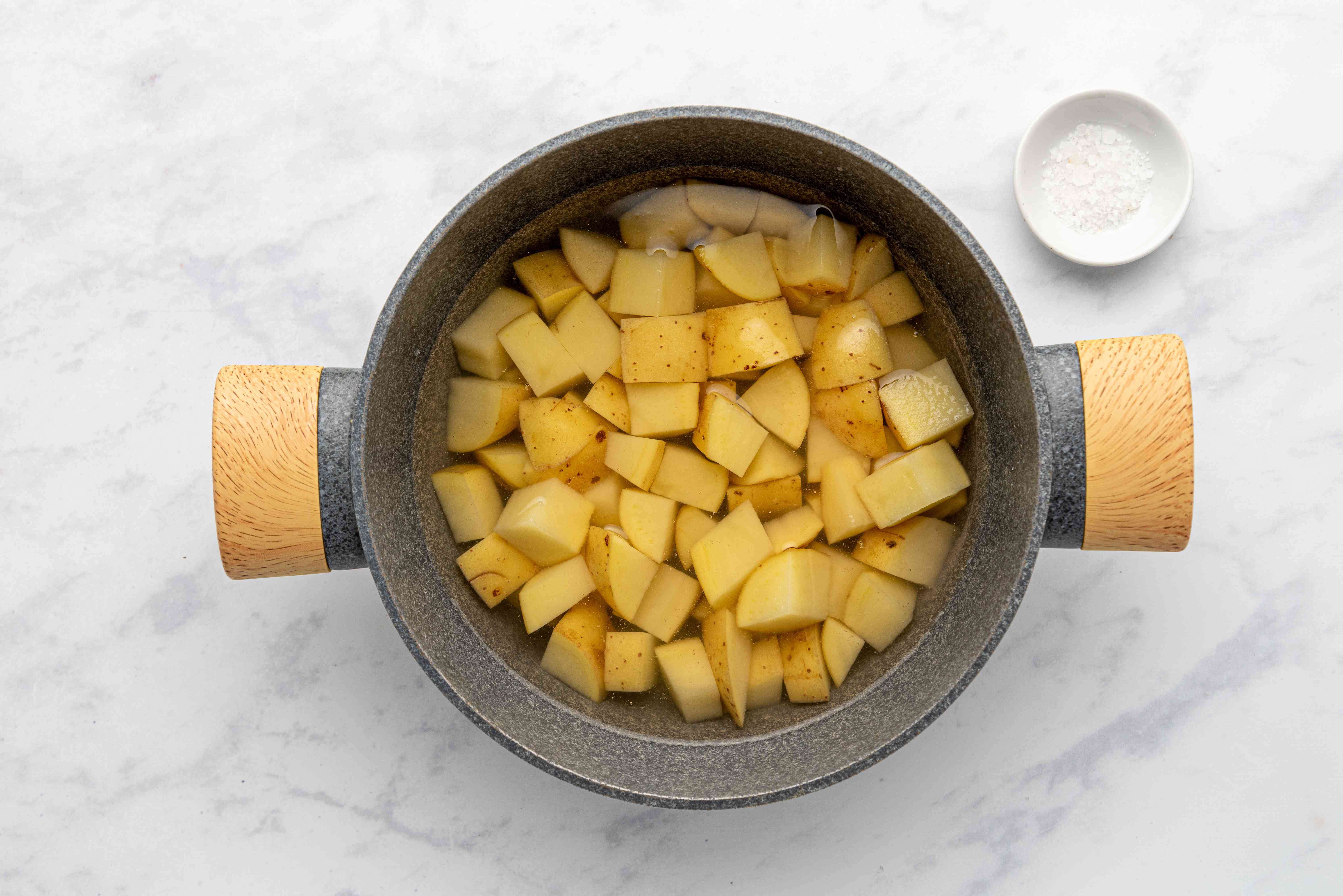 potatoes cooking in a pot with water