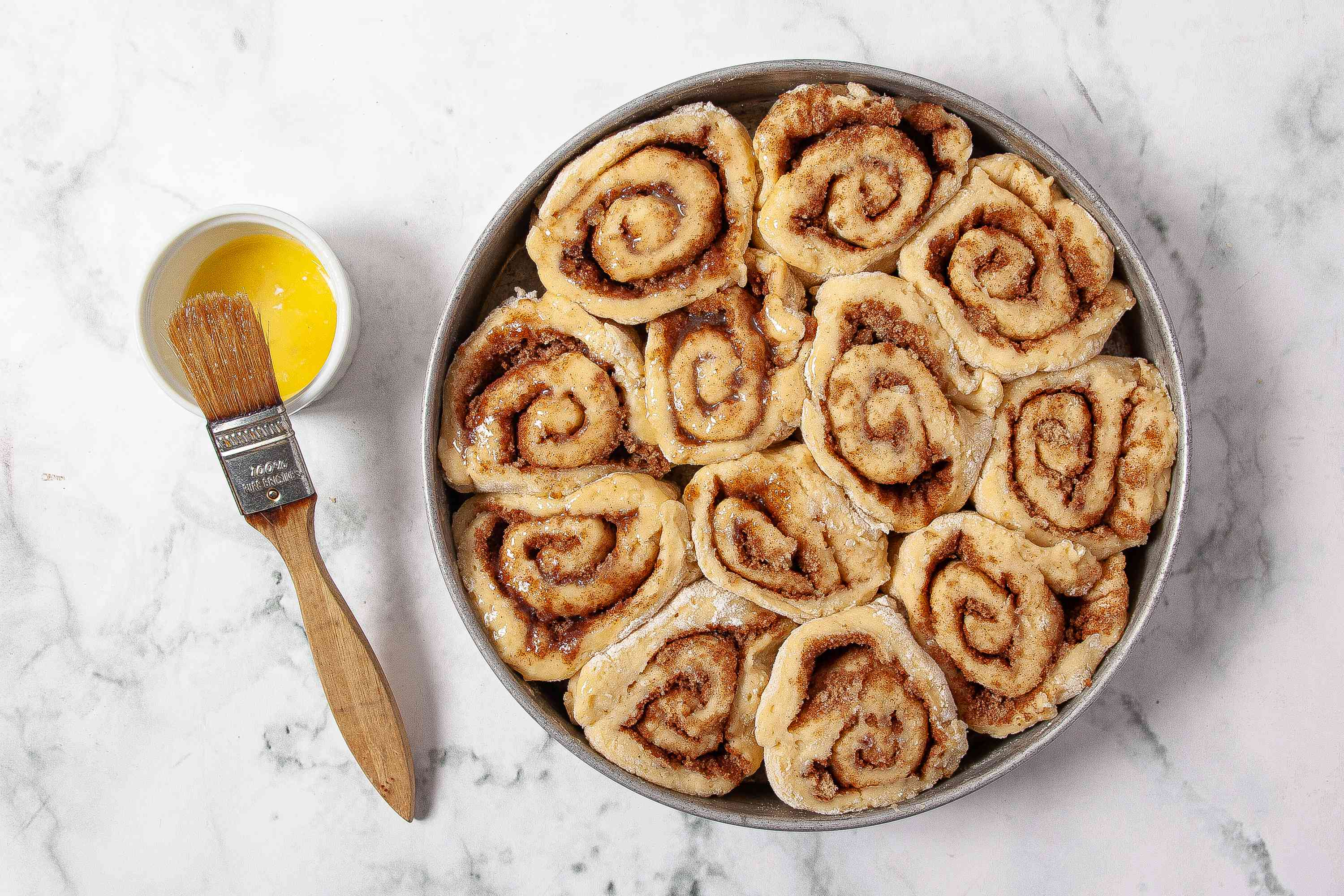 brush tops of cinnamon rolls with butter